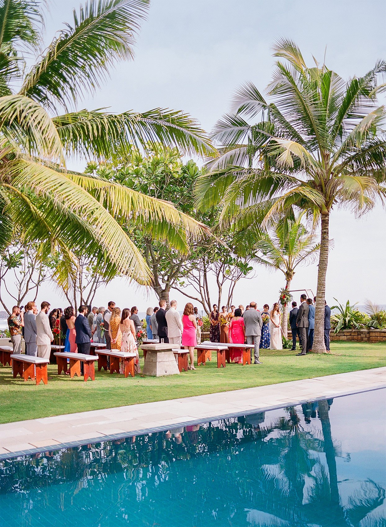 kelly sanjiv wedding ceremony under palm trees