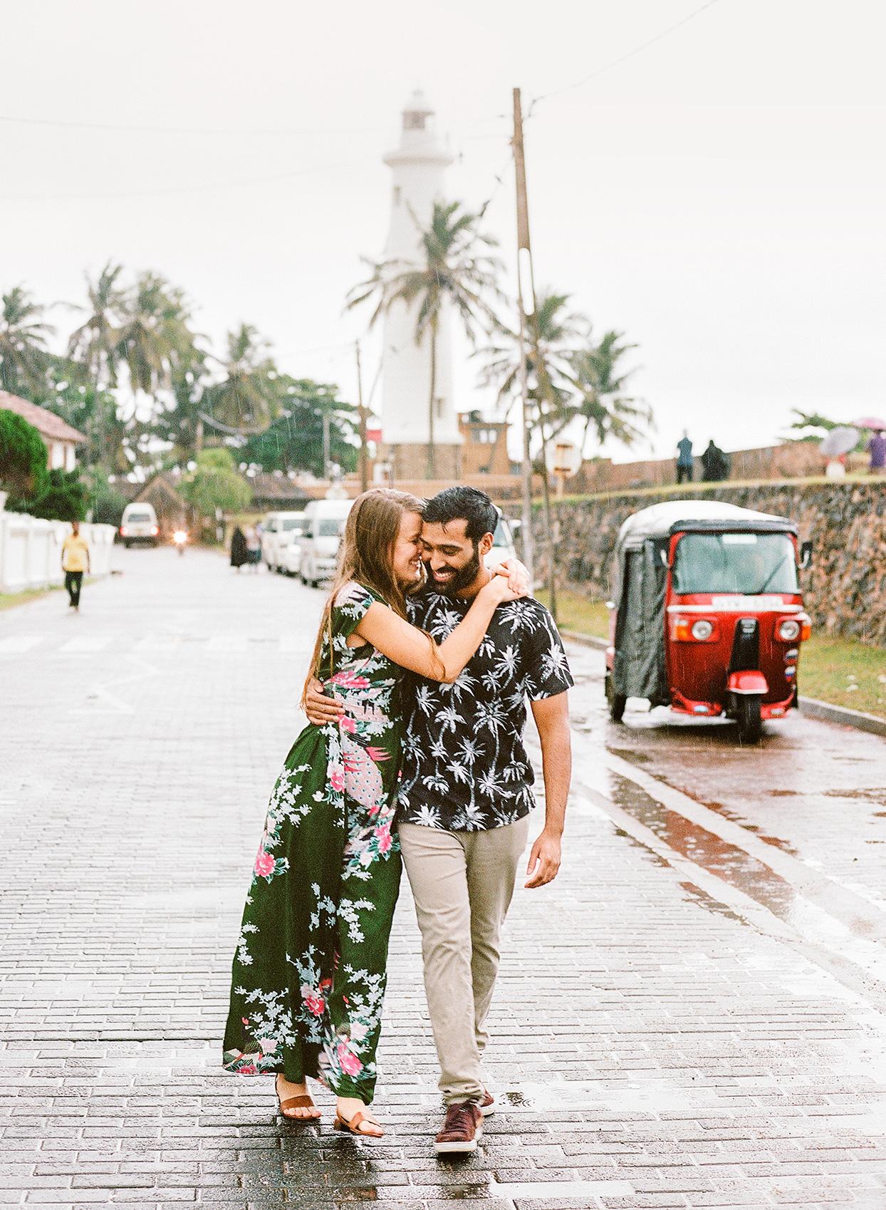 kelly sanjiv wedding couple walking in the rain