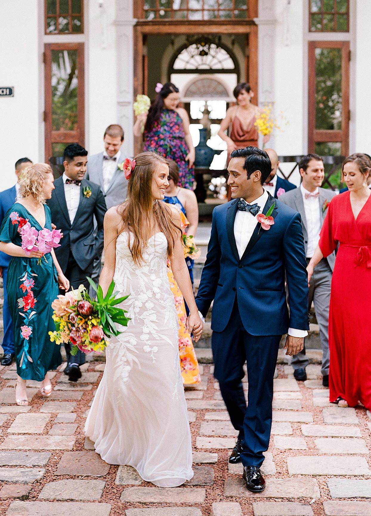kelly sanjiv wedding couple walking with party