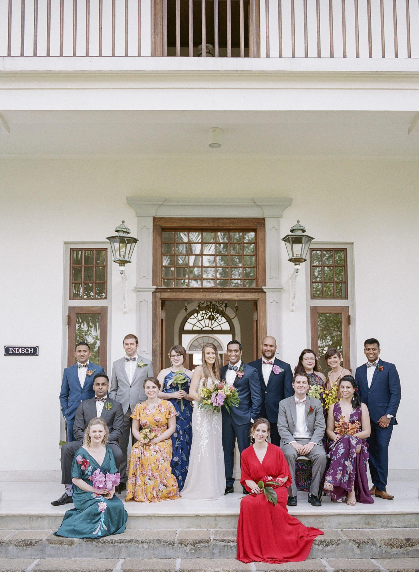 kelly sanjiv wedding couple with family