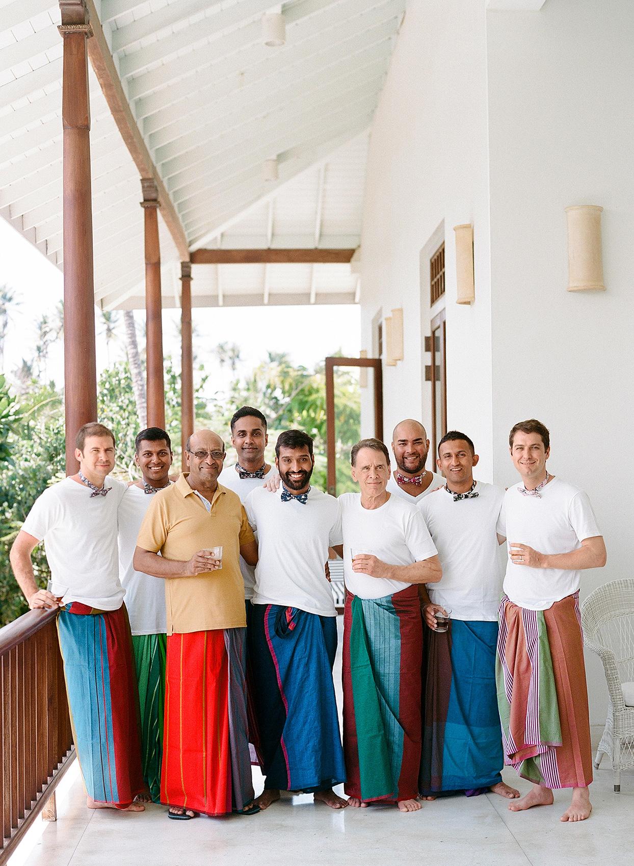 kelly sanjiv wedding groomsmen in sarongs