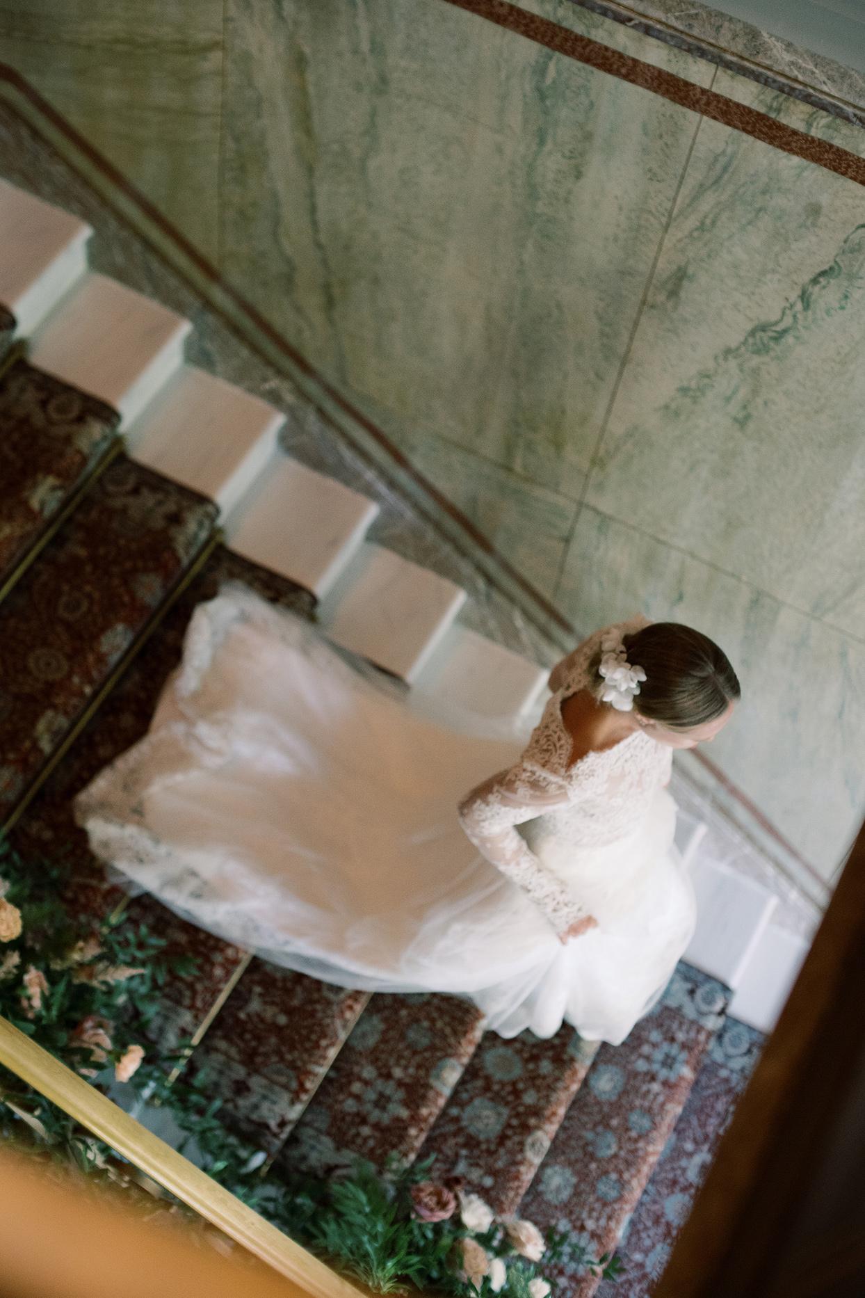laura alexander wedding bride walking downstairs
