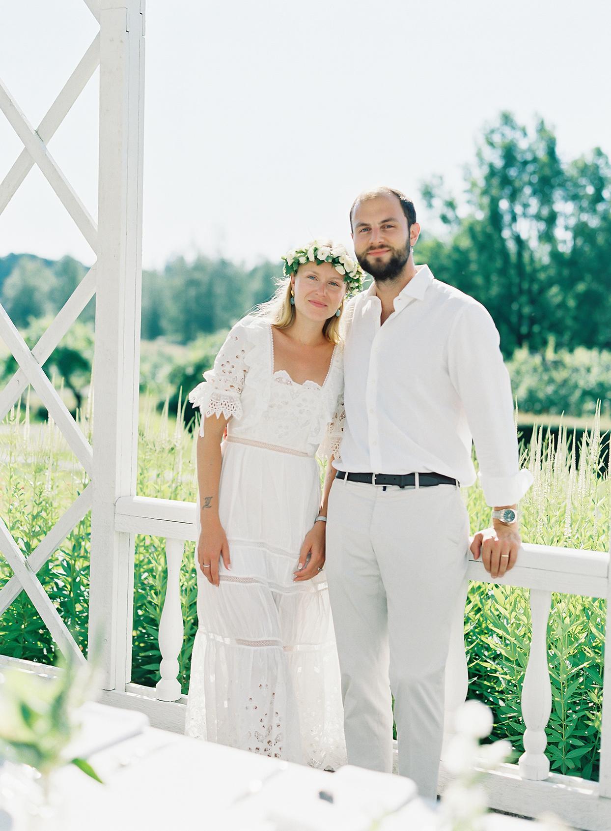 laura alexander wedding couple in white at brunch