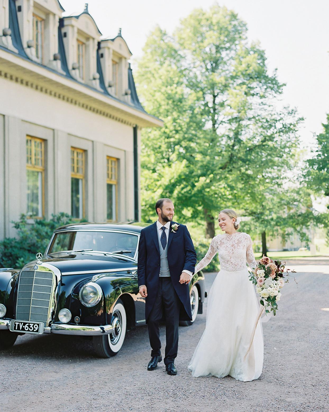 laura alexander couple walking by wedding car