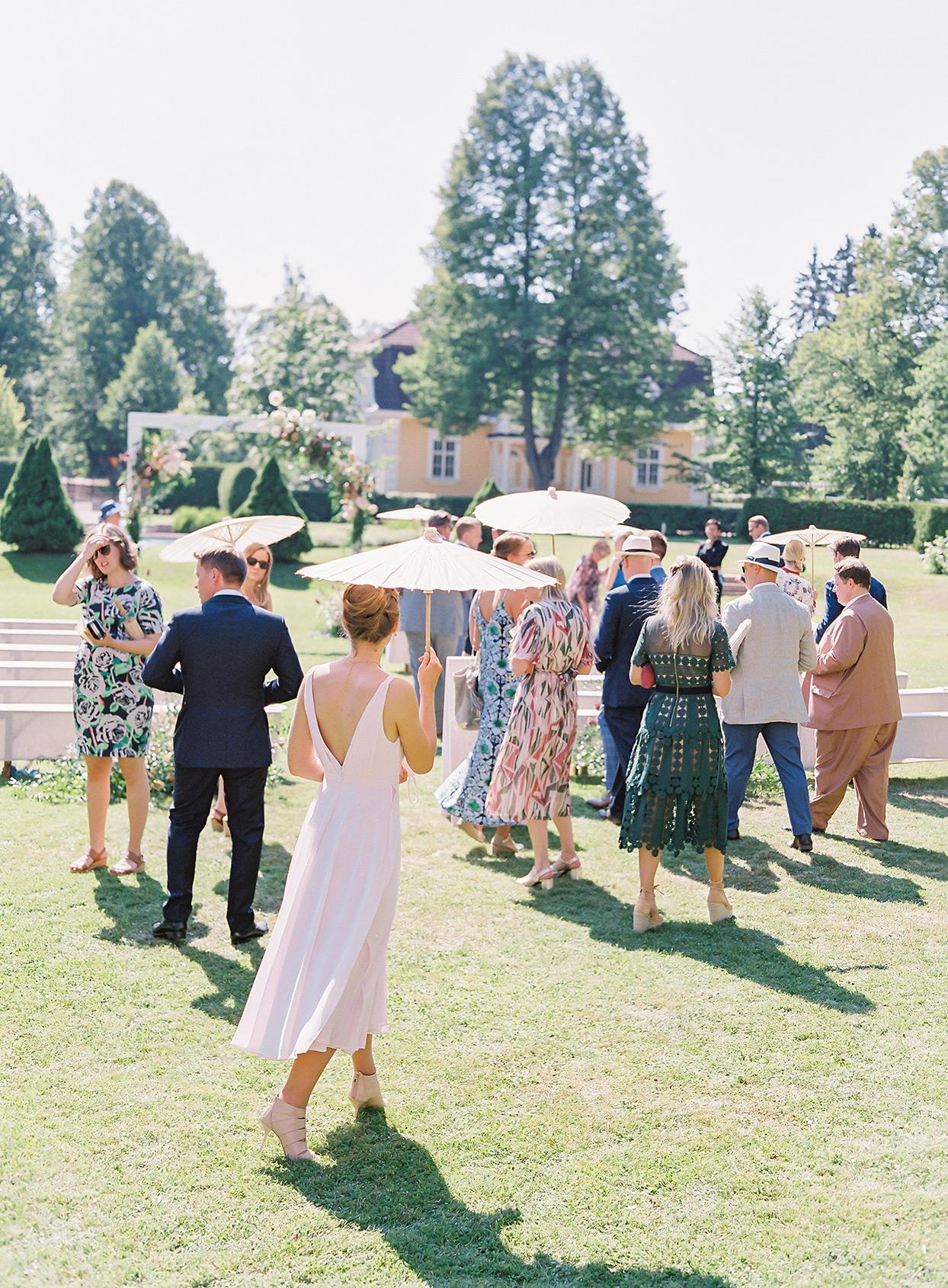 laura alexander wedding guests parasols