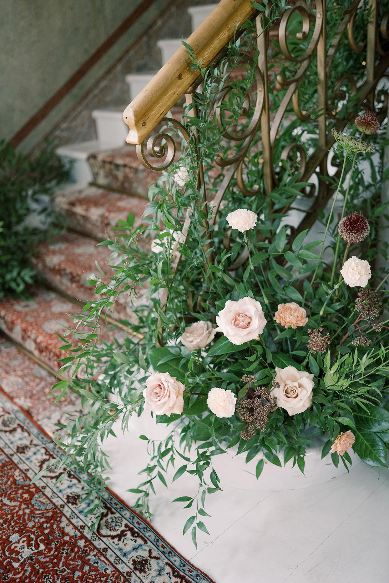 laura alexander wedding staircase flowers