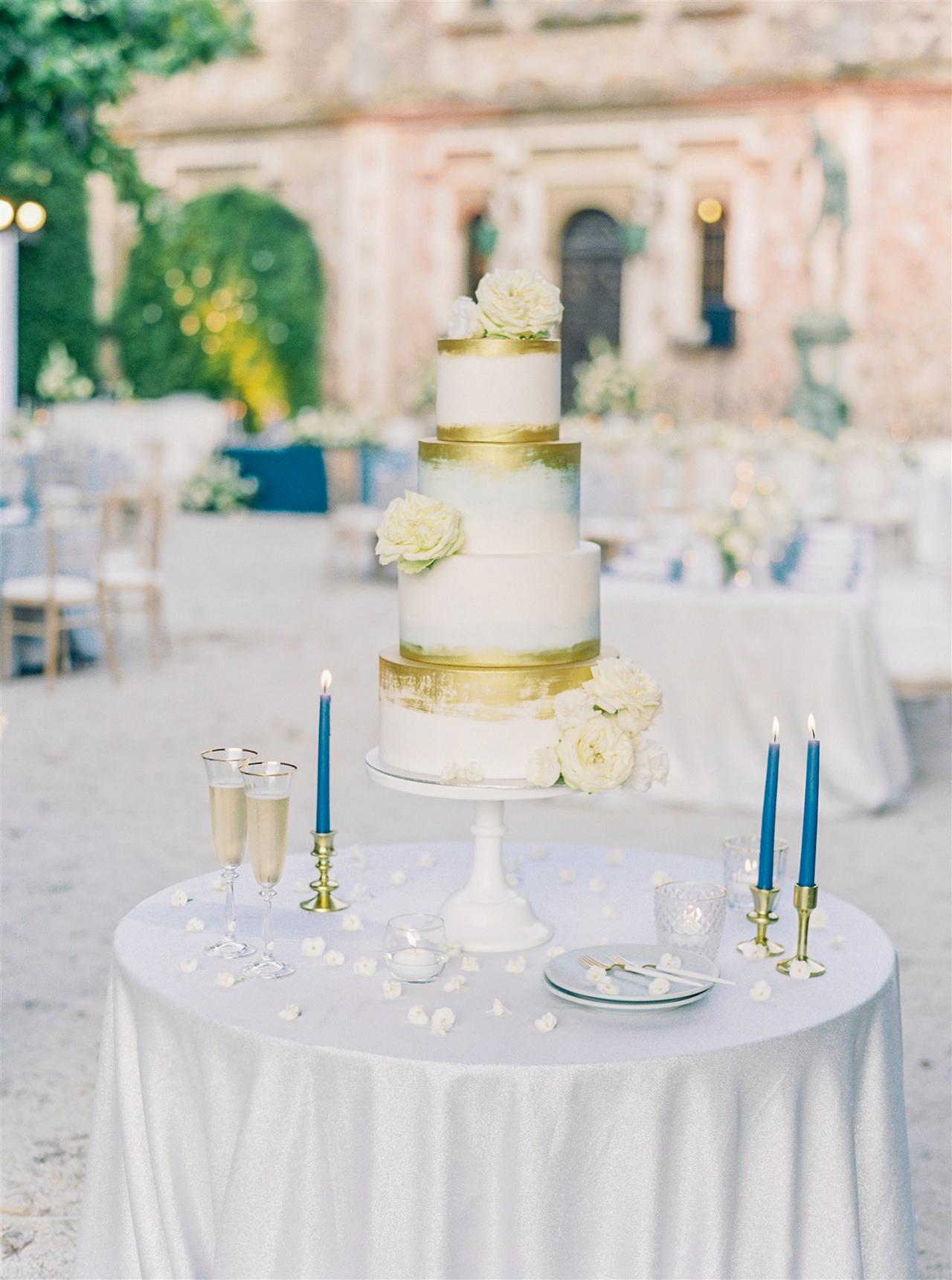 four tier blue gold white wedding cake