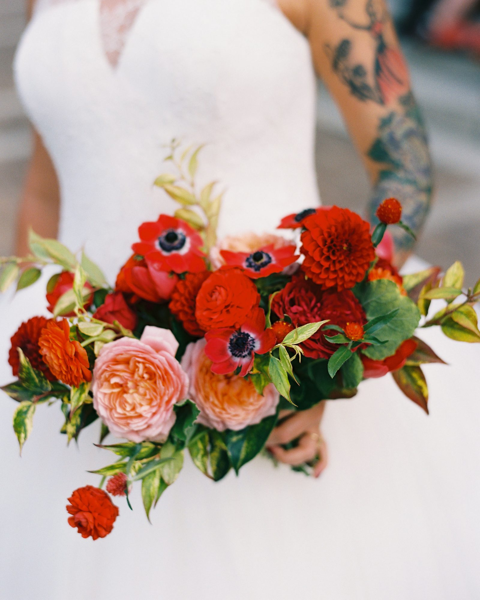 meaghan and david bride holding red monochomatic bouquet