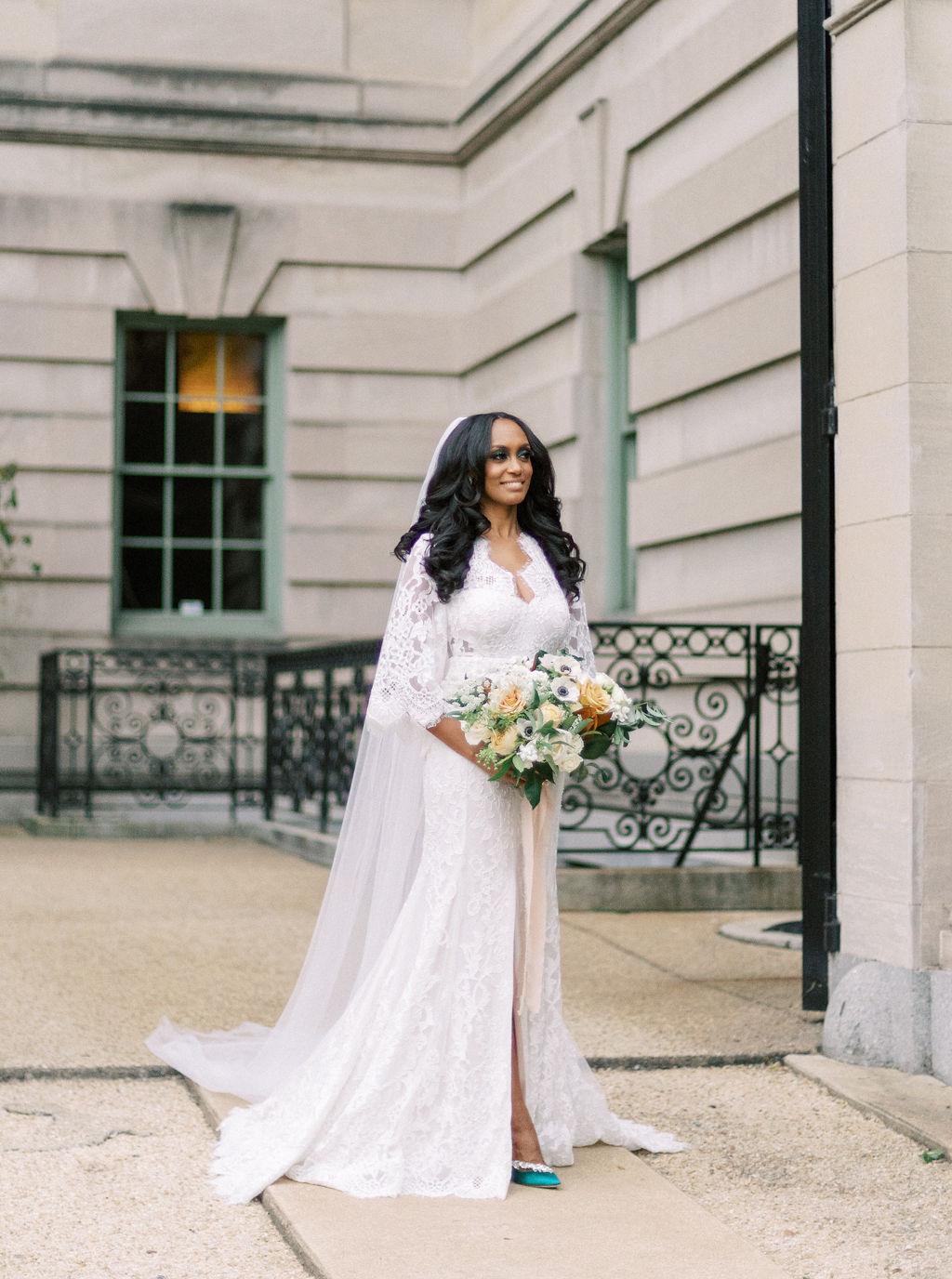 megan henock wedding bride portrait in courtyard