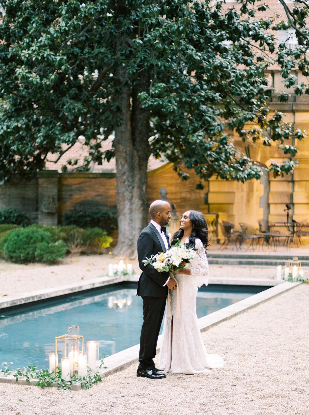 megan henock wedding couple portrait by pool