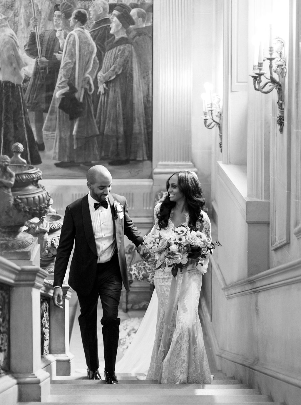 megan henock wedding couple walking up stairs to reception