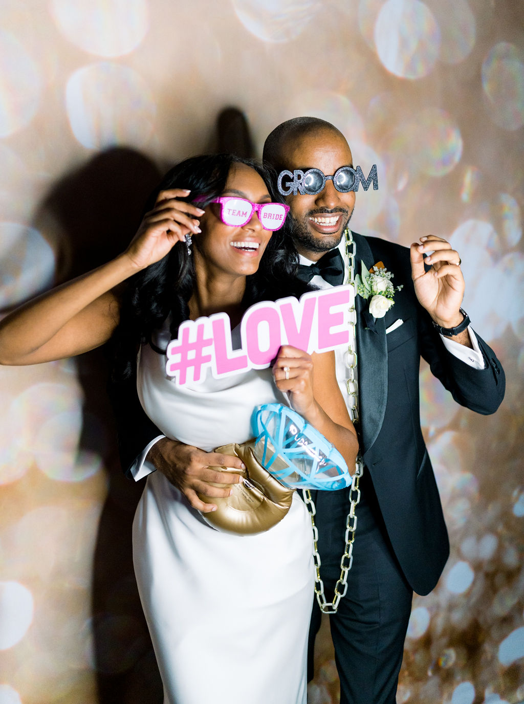 megan henock wedding couple with photobooth accessories