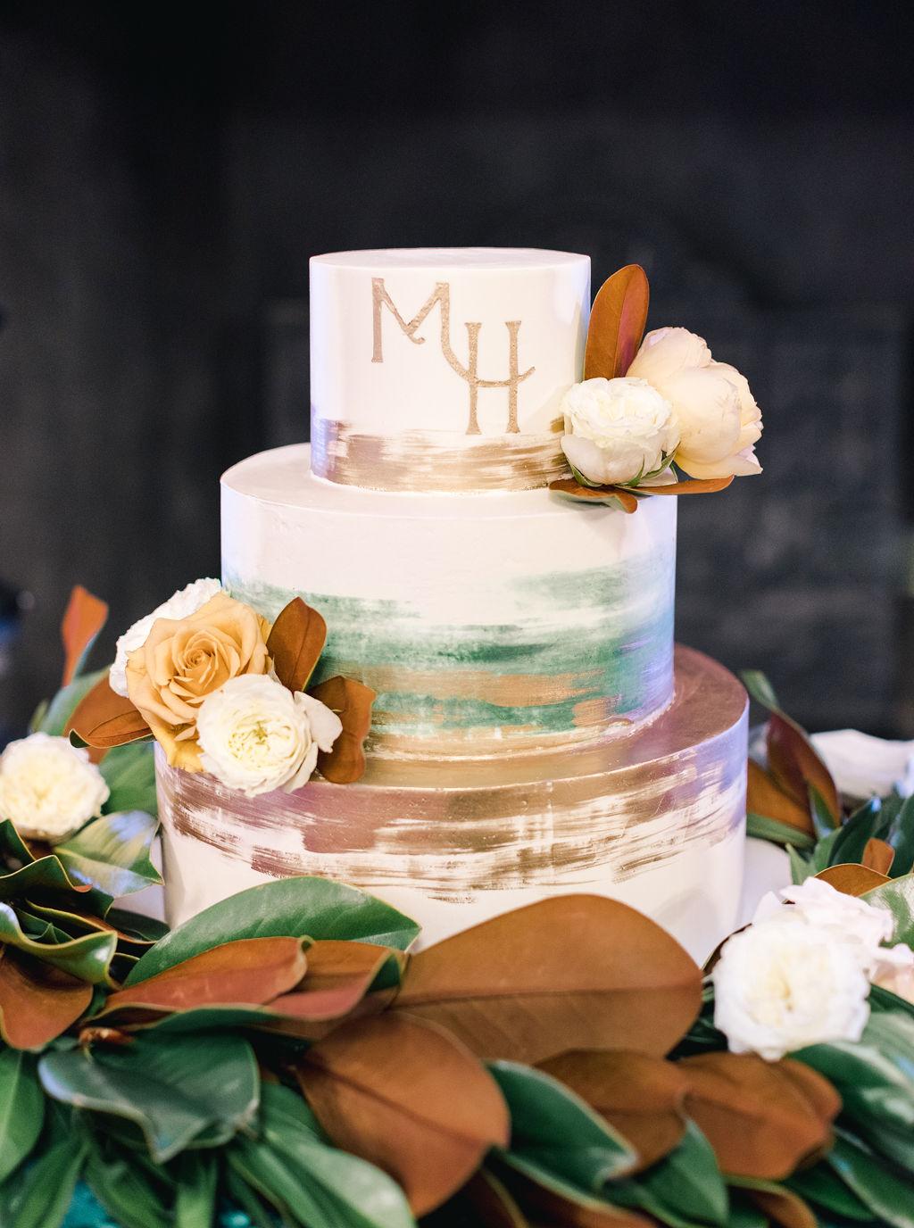 megan henock wedding reception earth tones cake