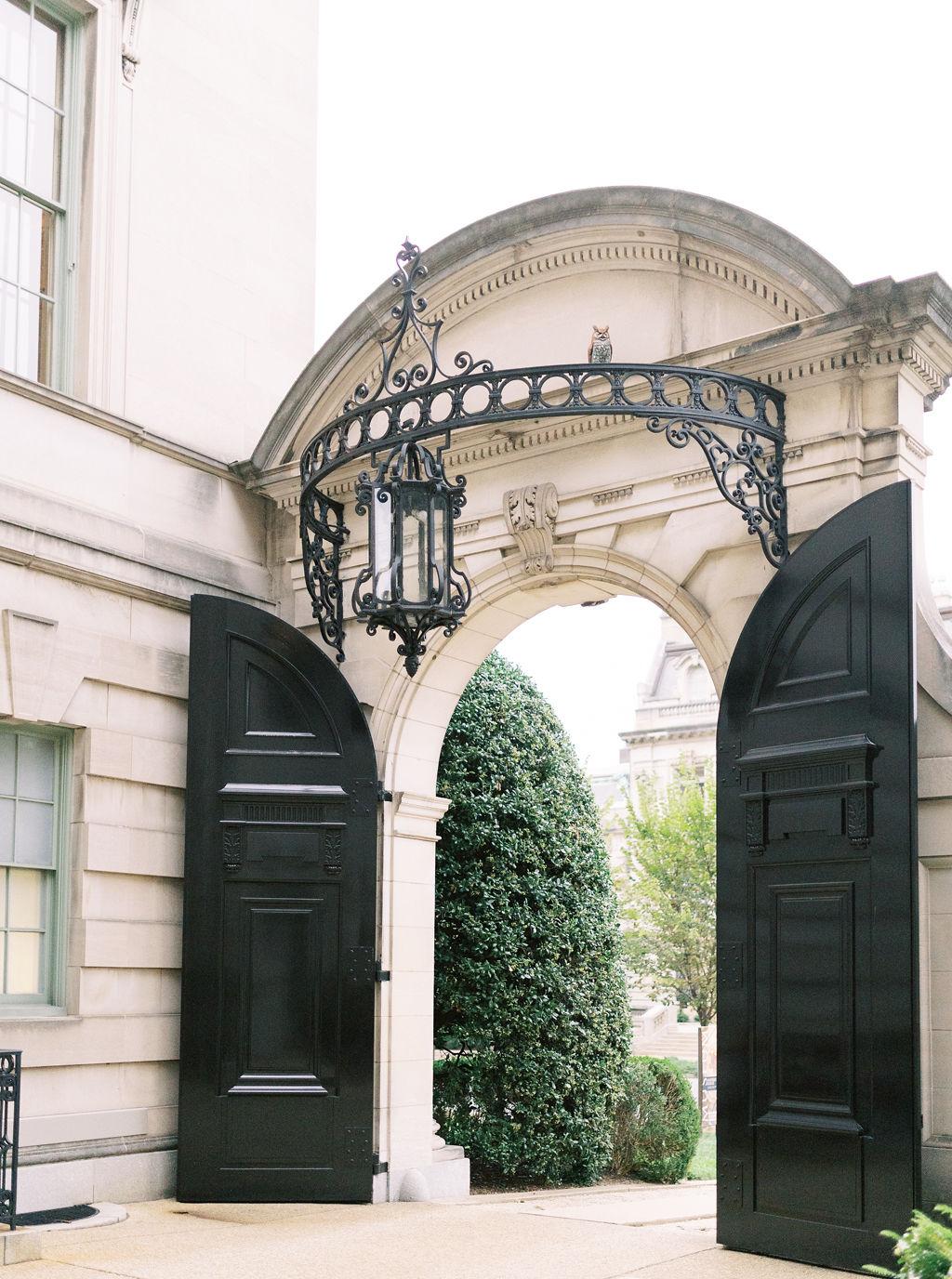 megan henock wedding venue exterior tall black doors