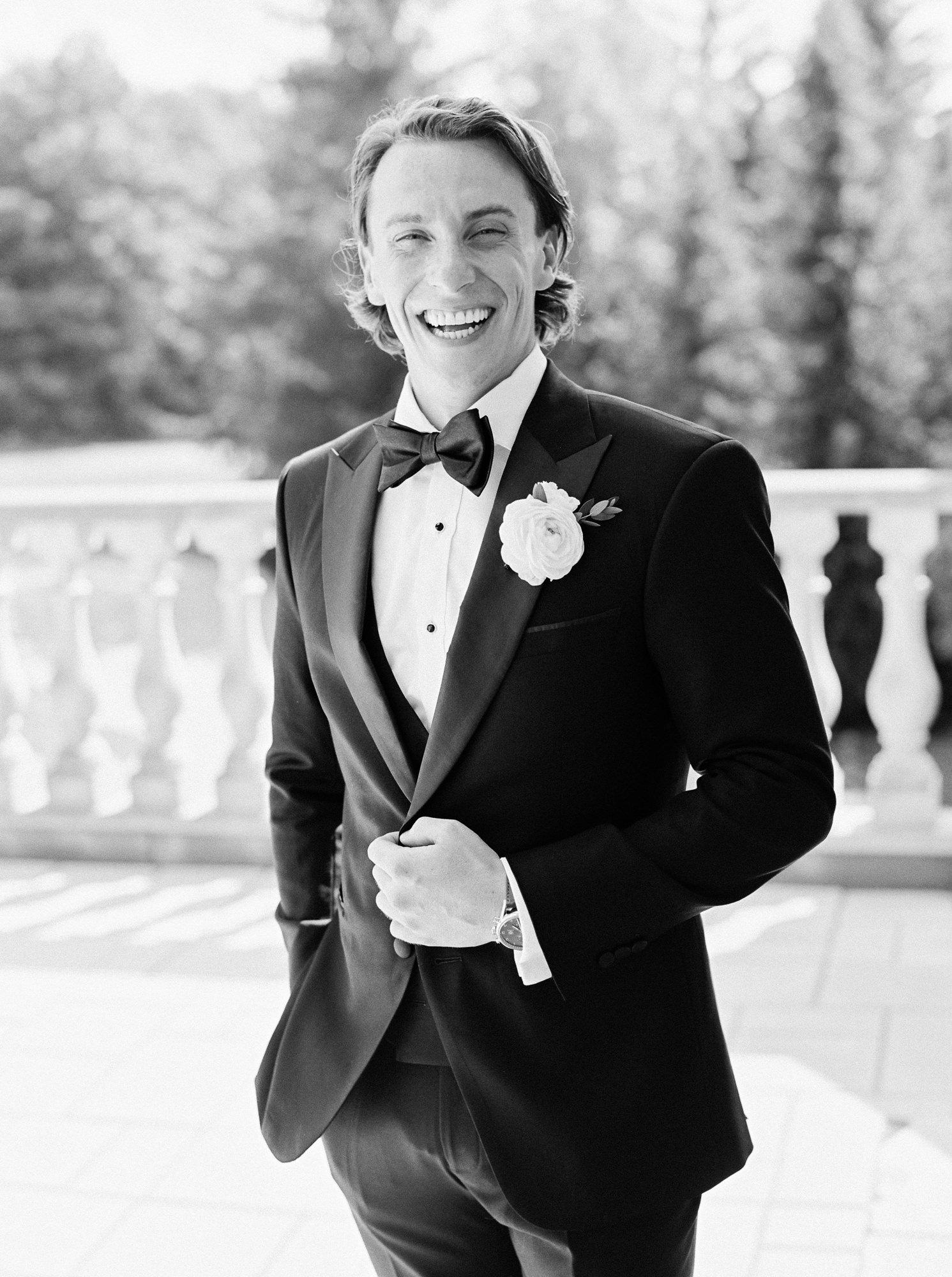 groom wearing Empire Customs black tuxedo
