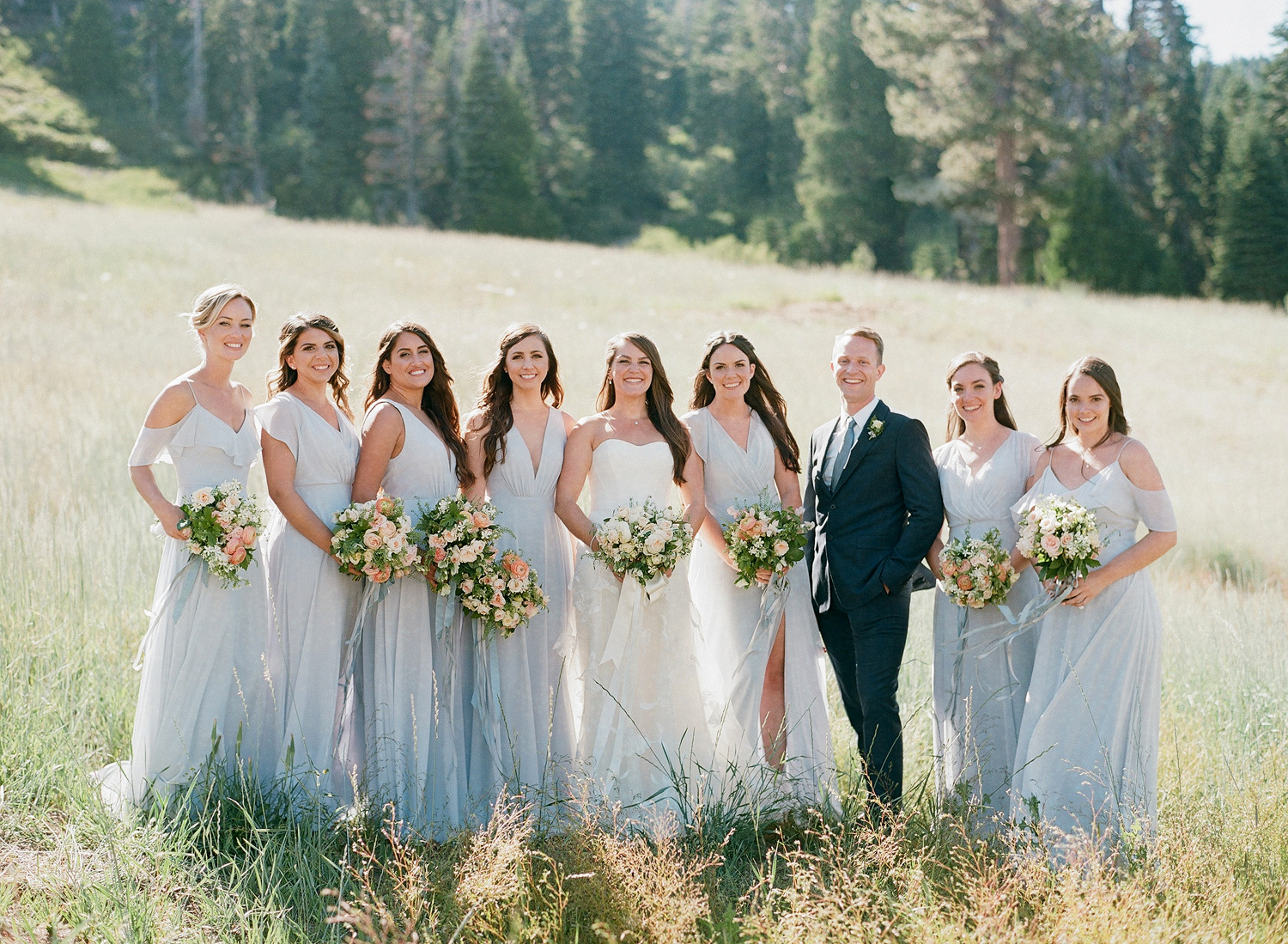 Natalie and Grant wedding bridesmaids and man of honor in blue