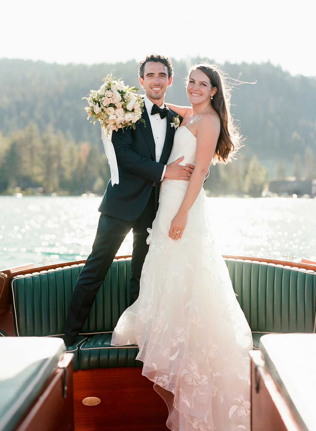 Natalie and Grant wedding bride and groom standing on boat