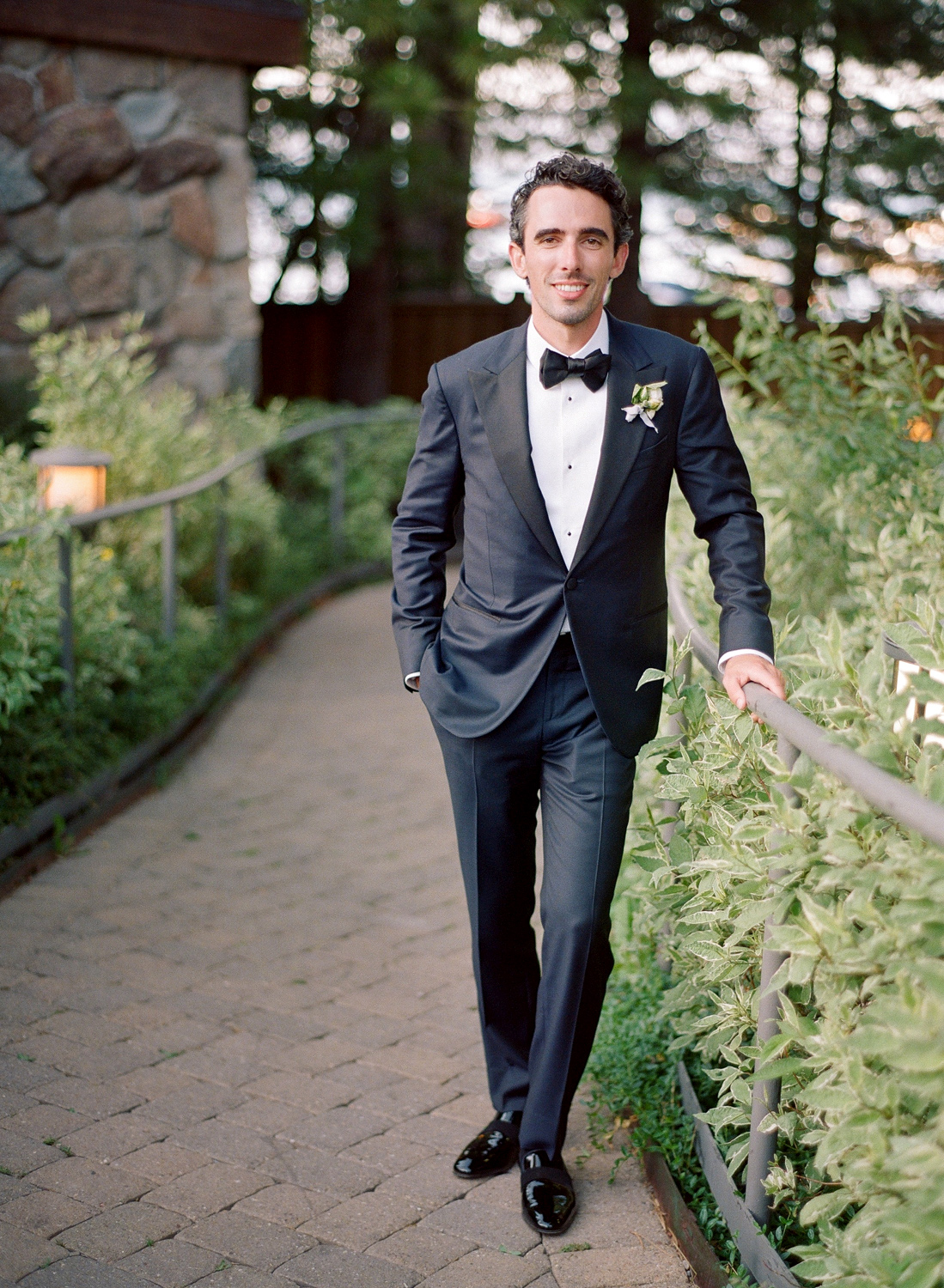 Natalie and Grant wedding groom's portrait on outdoor path