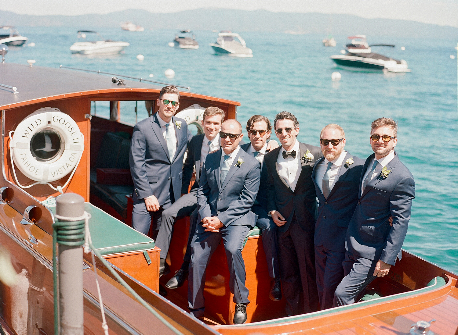 Natalie and Grant wedding groomsmen on red boat