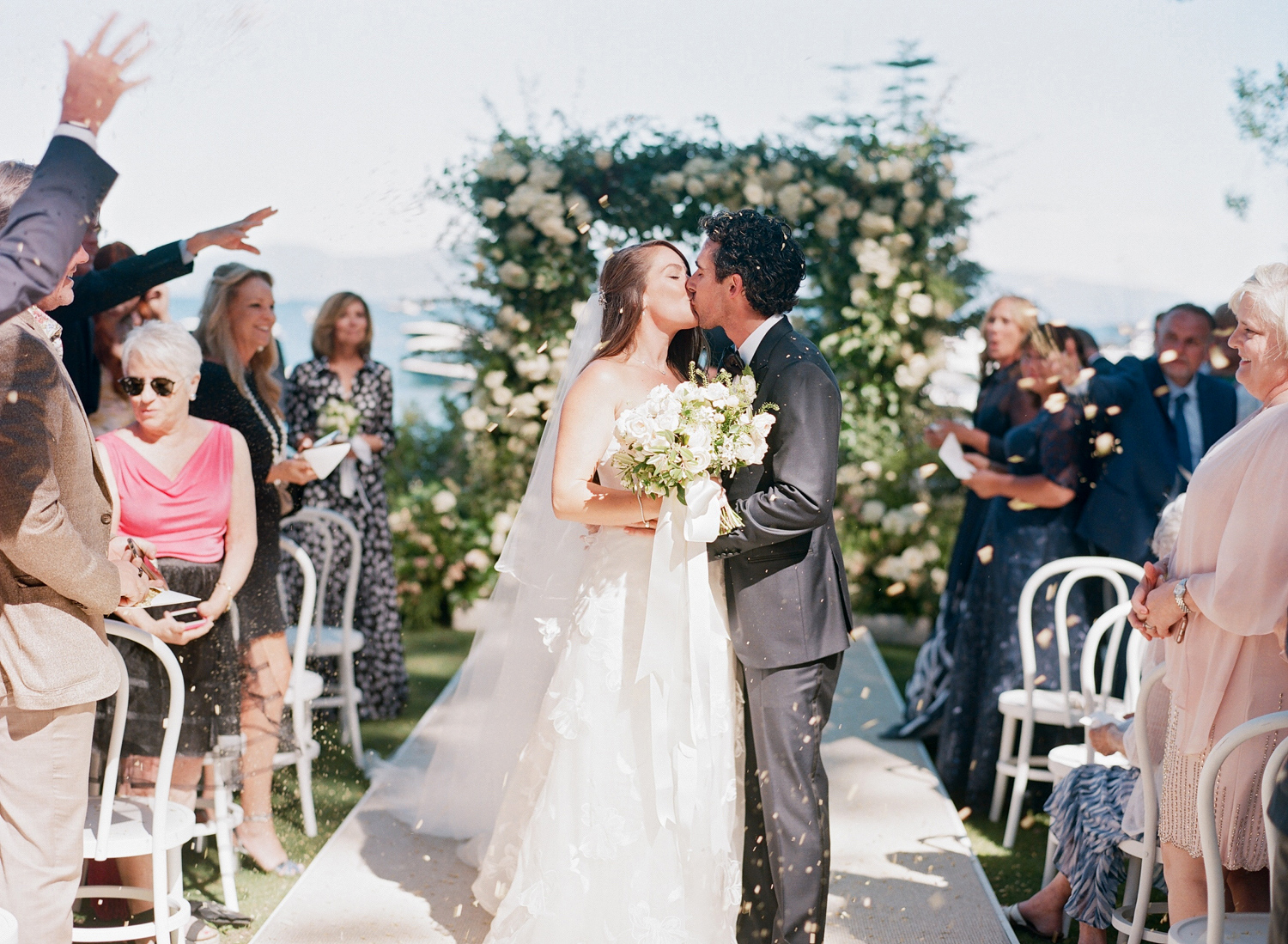 Natalie and Grant wedding recessional bride and groom kissing