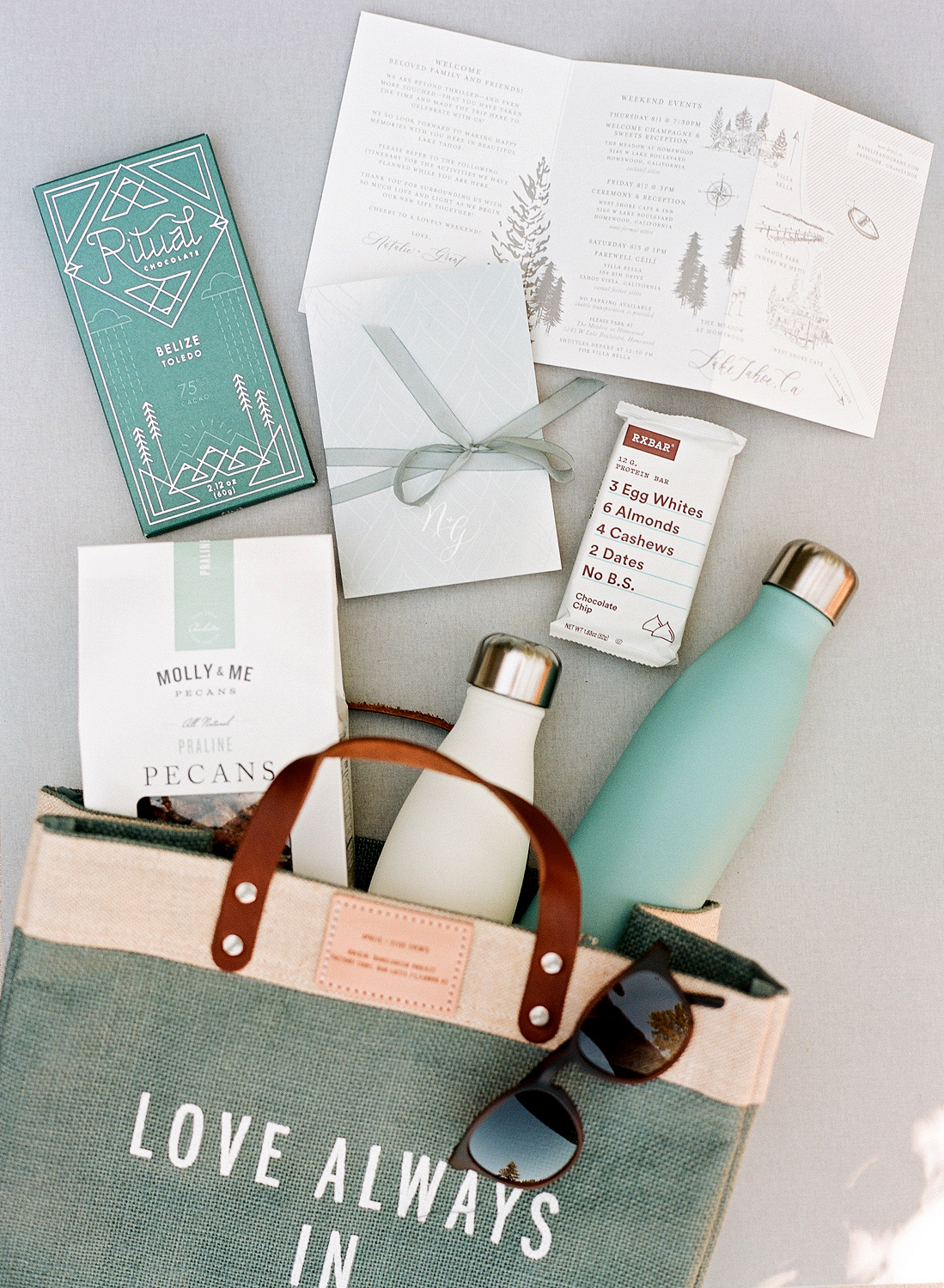 Natalie and Grant wedding welcome bags with totes, sunglasses and treats