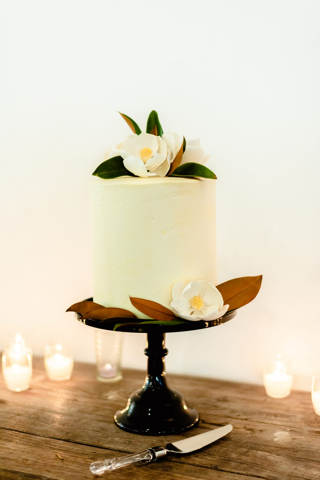 ryan shep wedding cake with white floral accents
