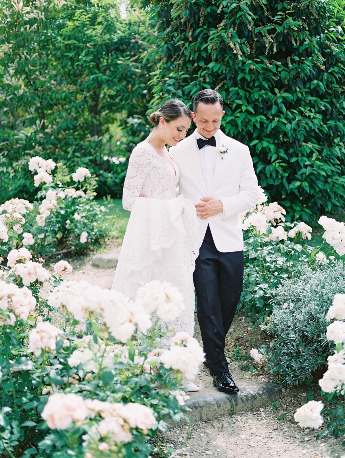 saghar ben wedding couple walking through garden