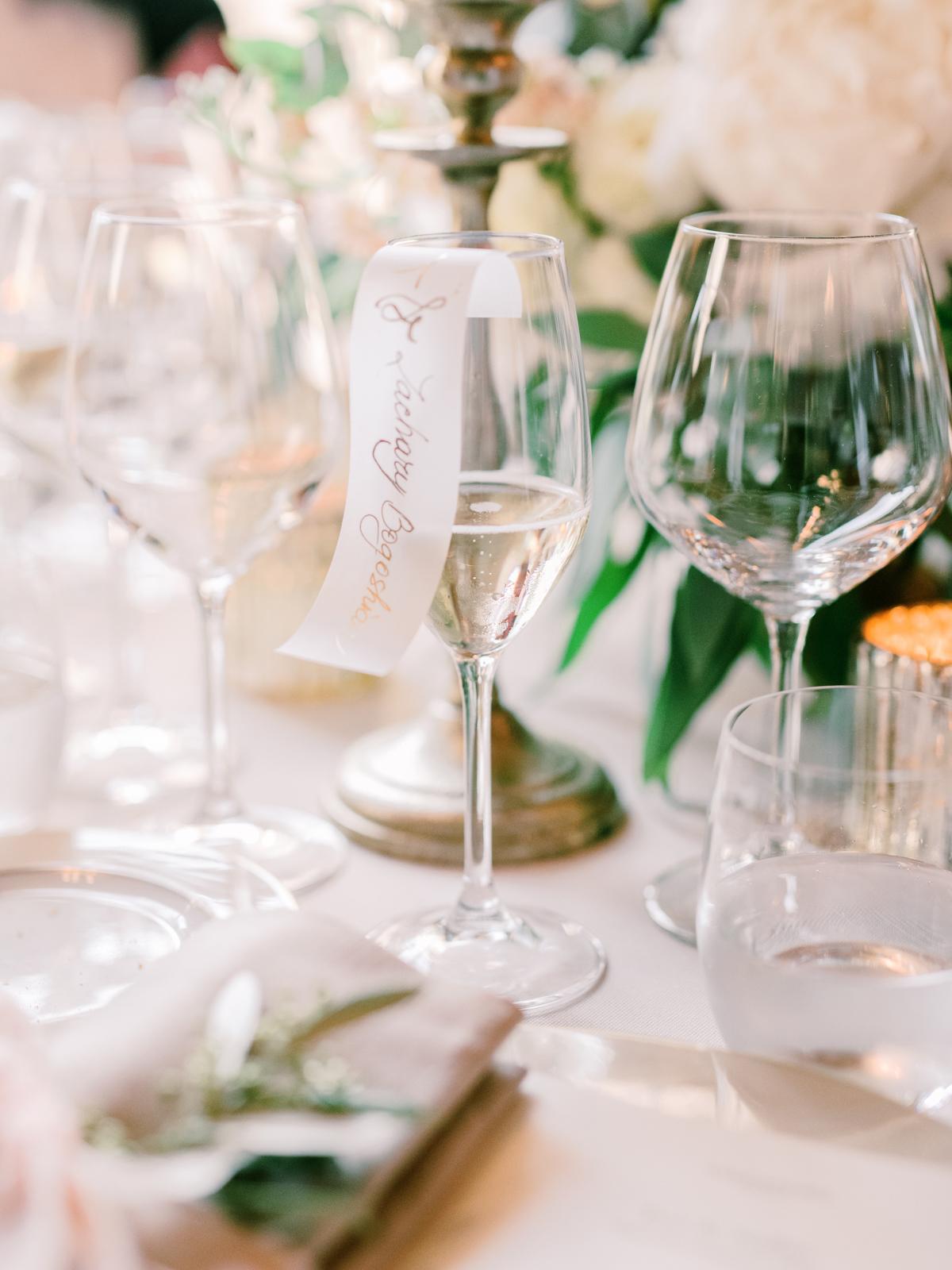 saghar ben wedding place cards on champagne glasses