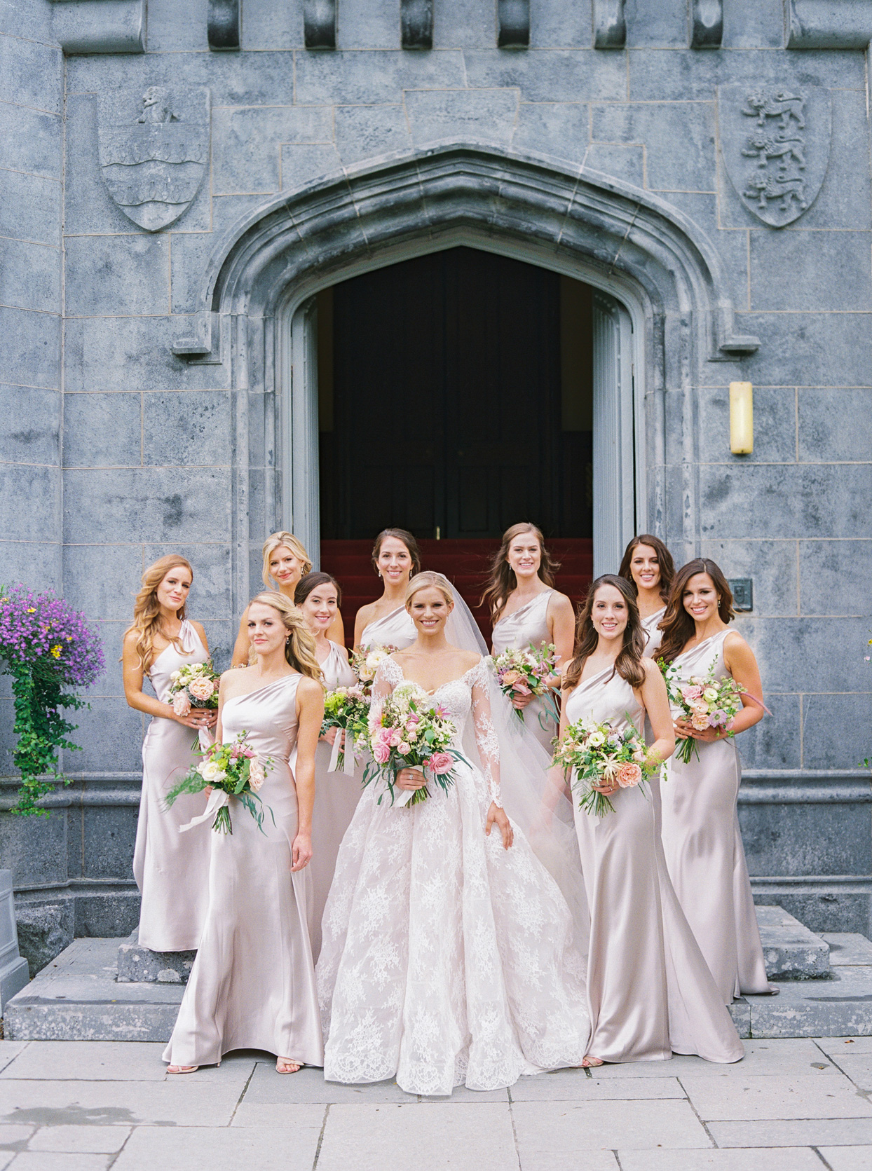 bridesmaids wearing floor length one-shoulder satin Jenny Yoo dresses