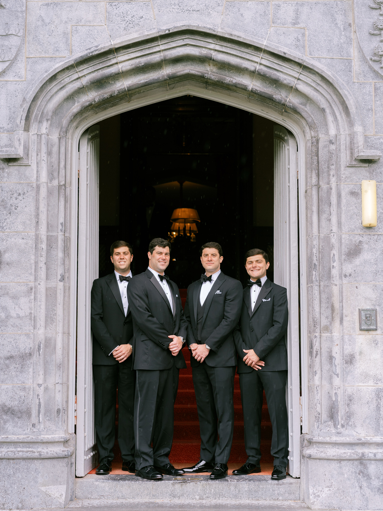 groom and groomsmen wearing black Ralph Lauren Purple Label tuxedos