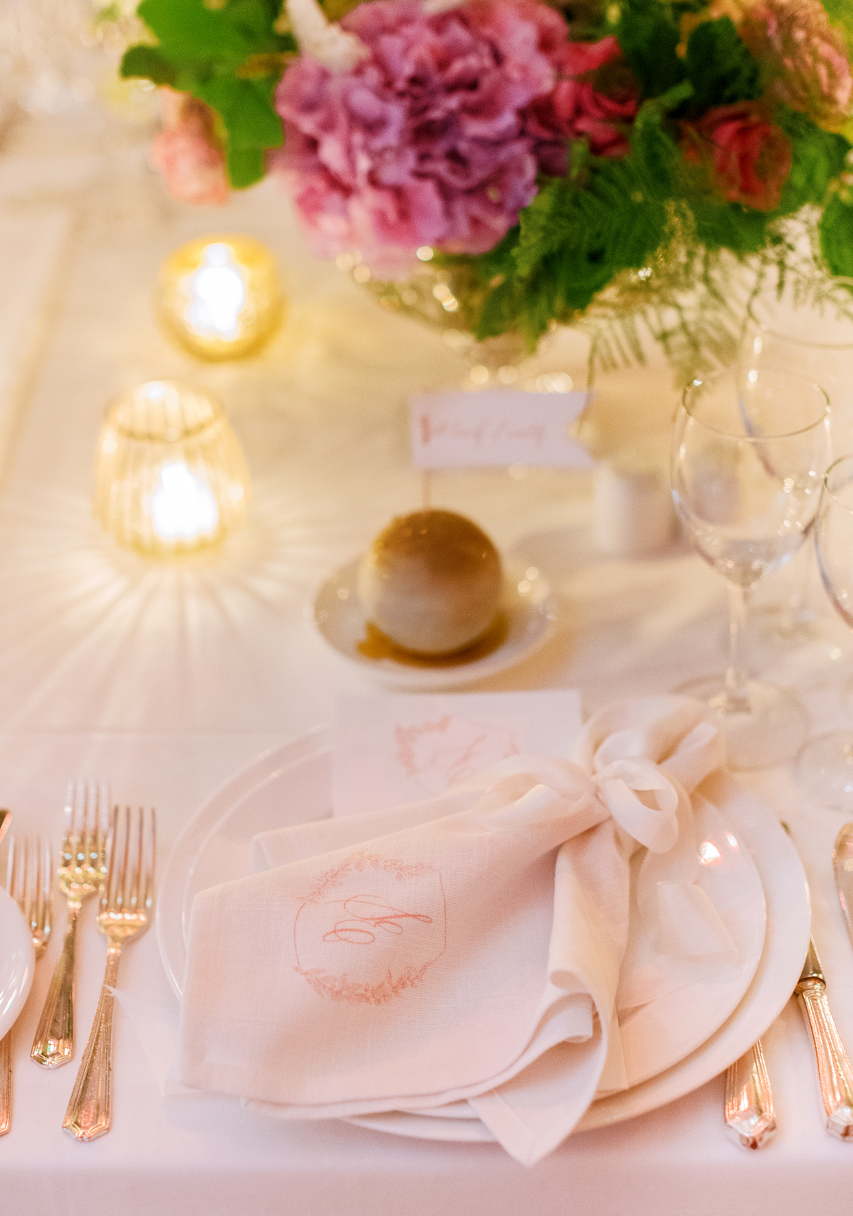 monogrammed hemstitch napkin topped placesetting