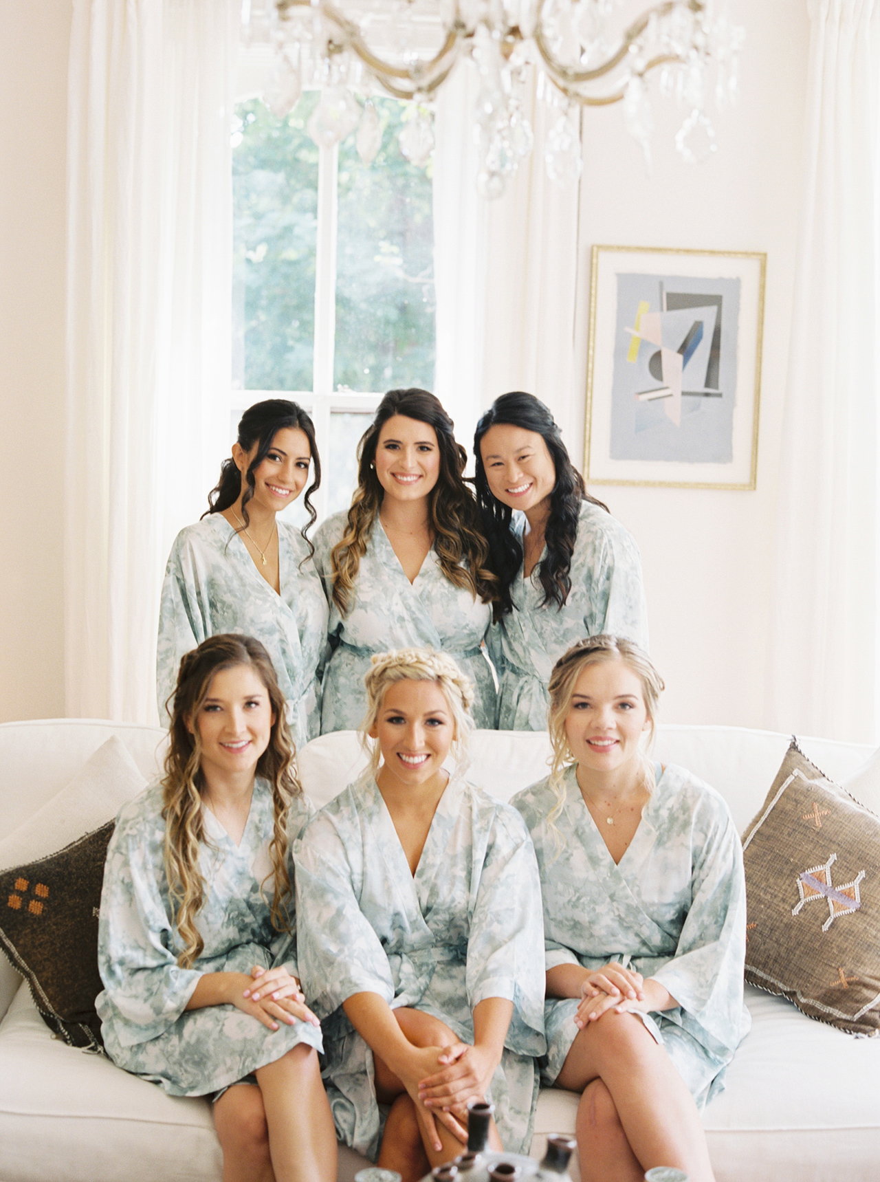 bridesmaids matching robes getting ready