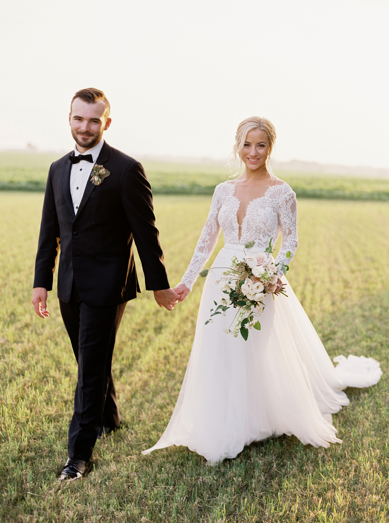 bride groom walking outdoors grass field