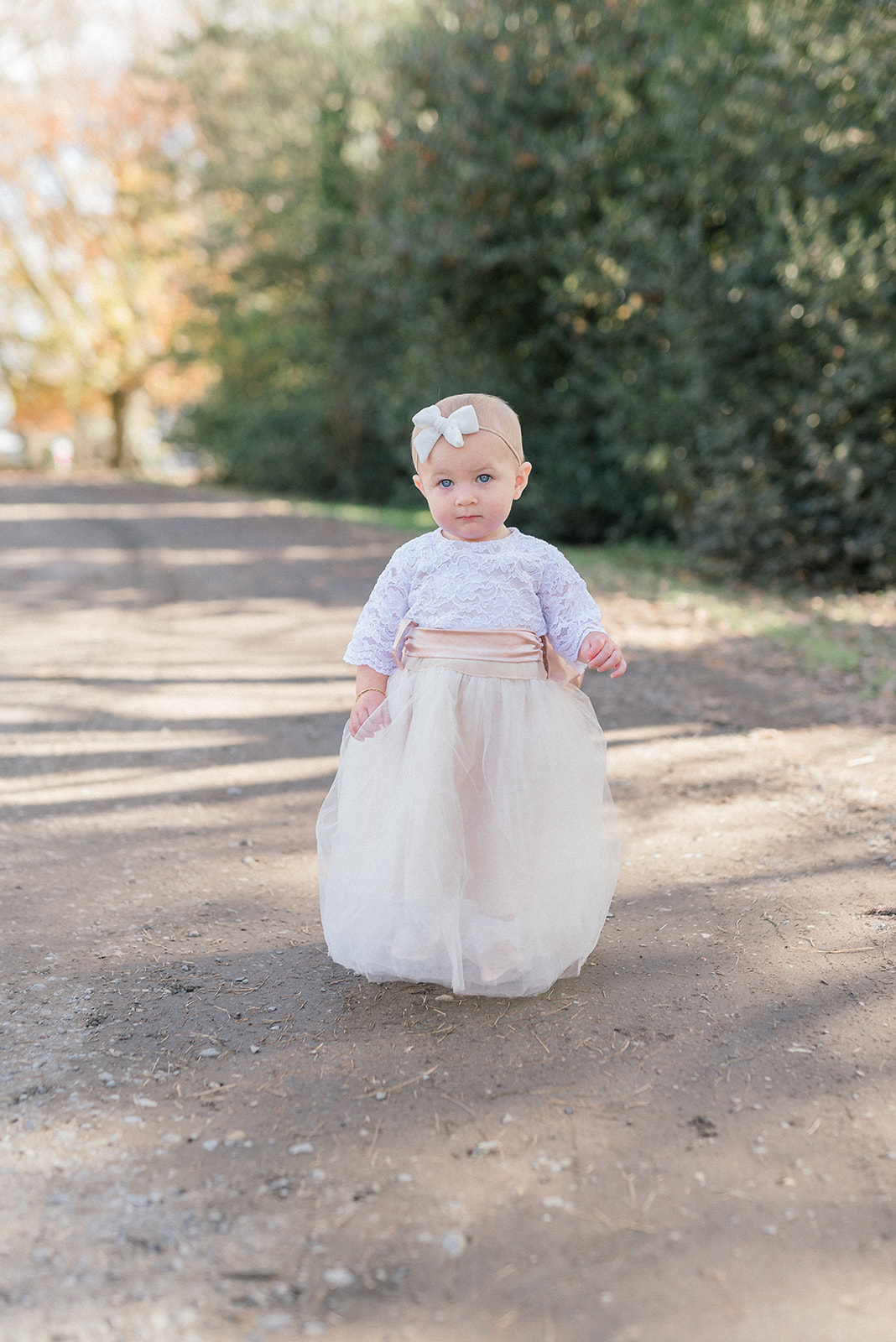 little girl with bow headband and tulle skirt dress