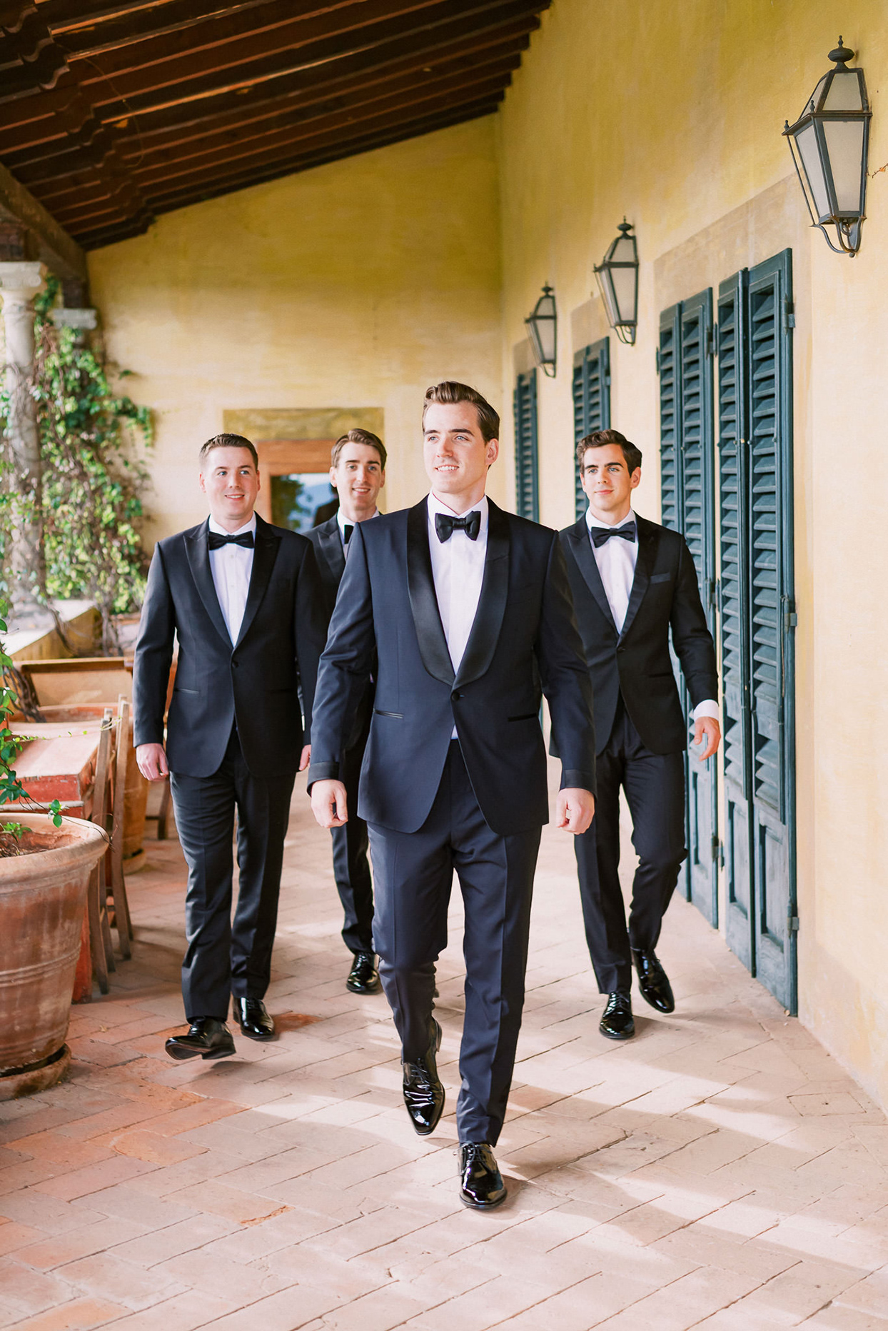 ally brian wedding groomsmen walking