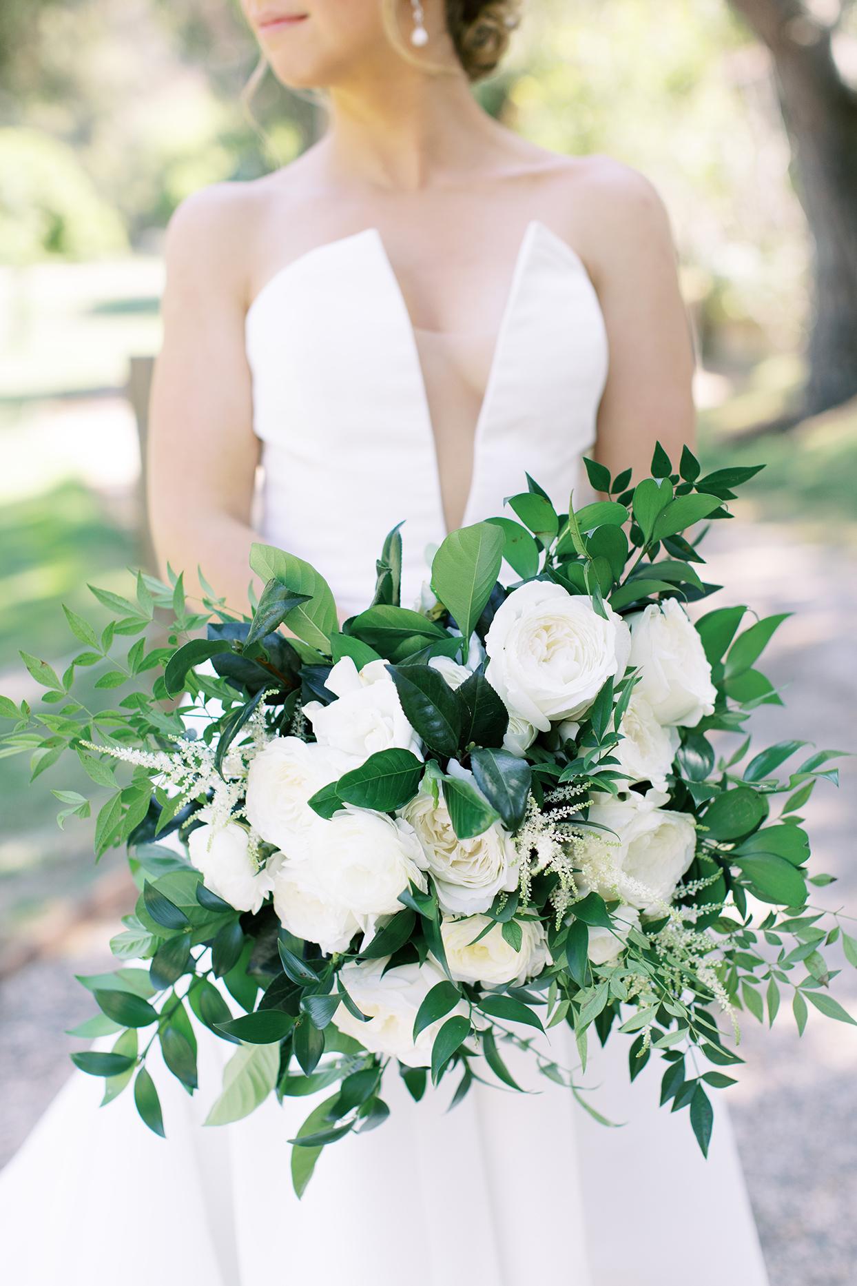 amanda will bride holding wedding bouquet