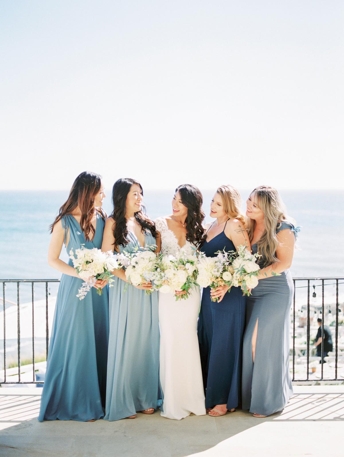 bettina gino wedding bridesmaids in blue on balcony