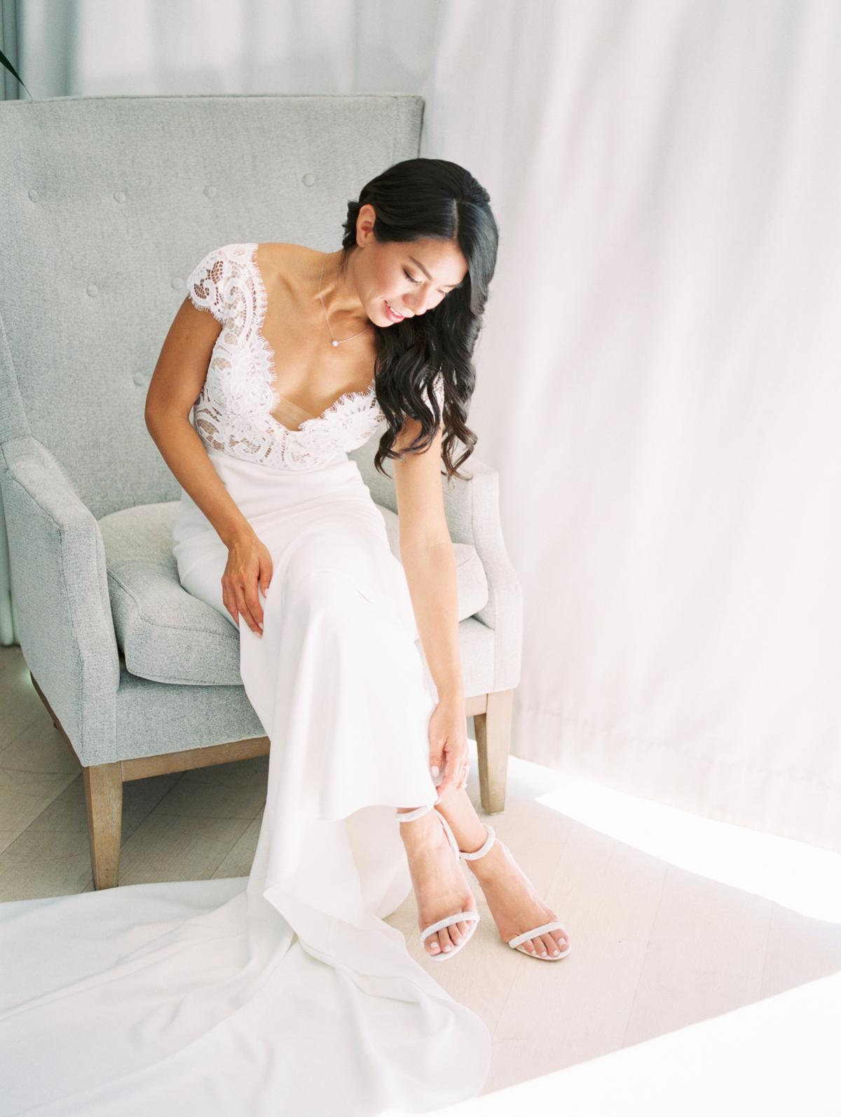 bettina gino bride sitting in wedding dress
