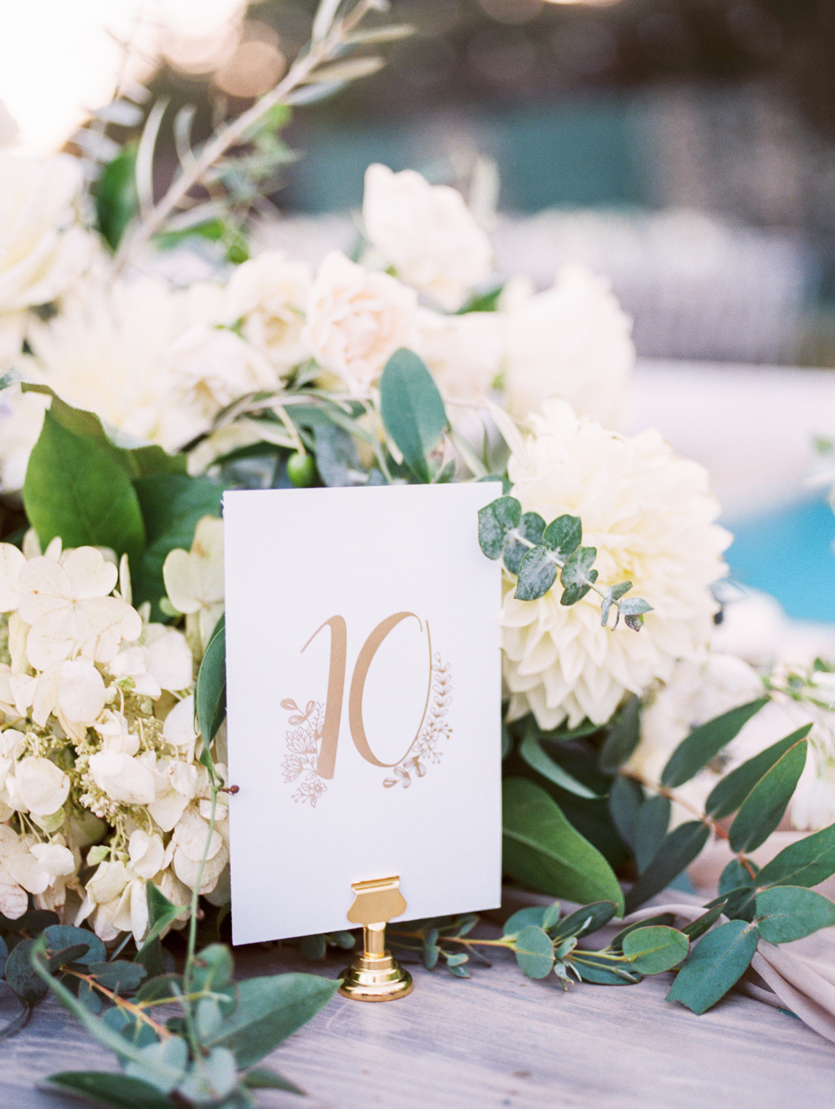 bettina gino wedding reception gold and white table numbers