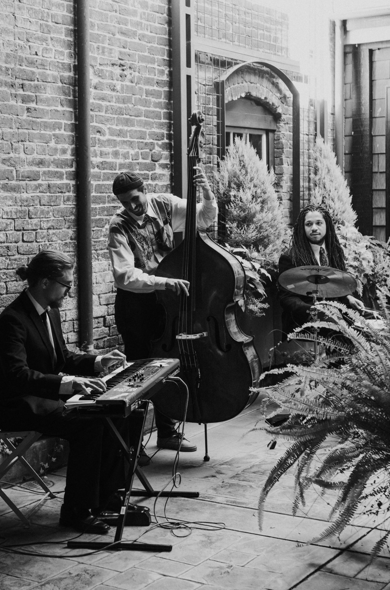 jazz trio playing on outdoor patio