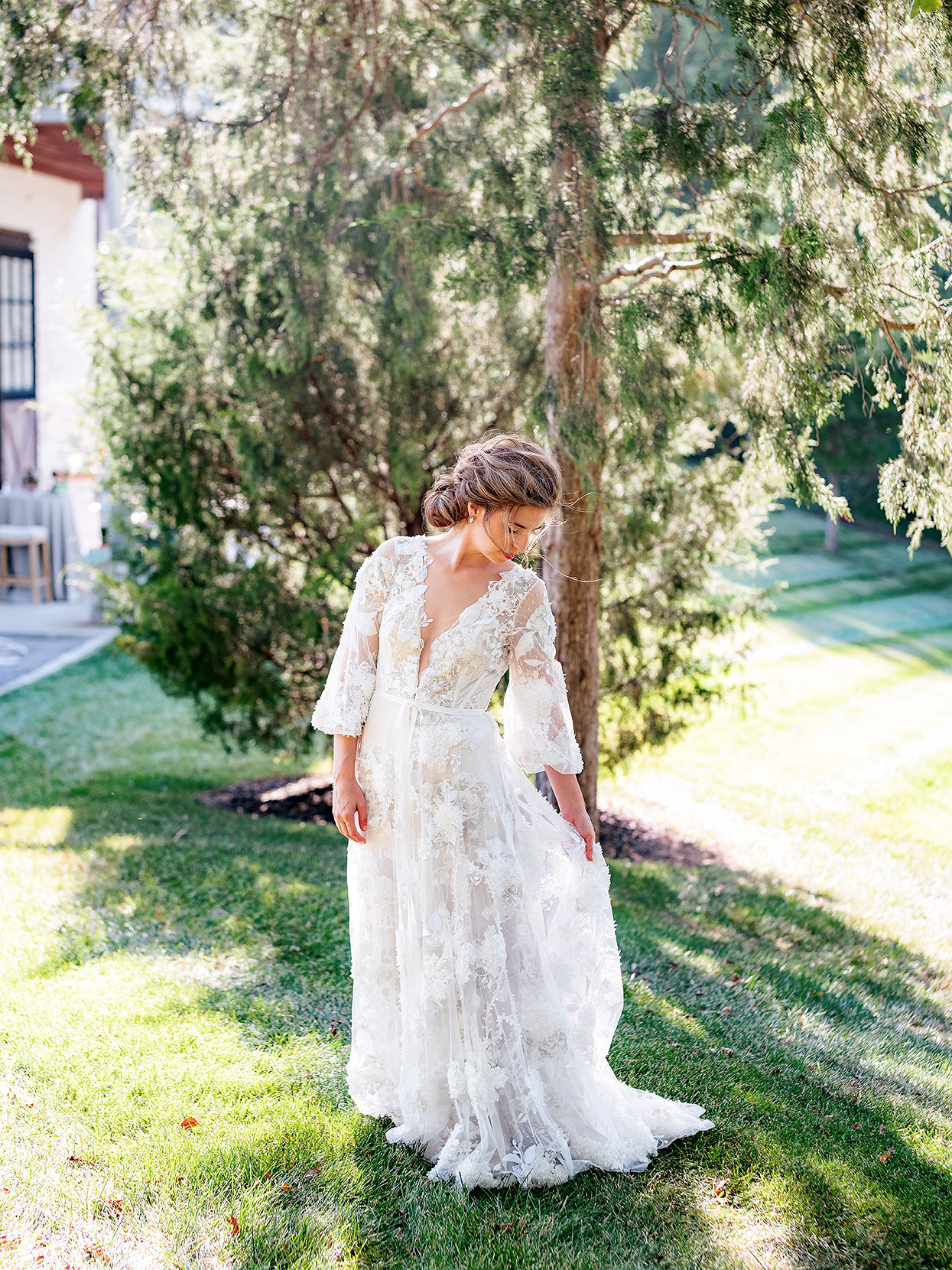 The bride Claire with lace v-neck romantic gown