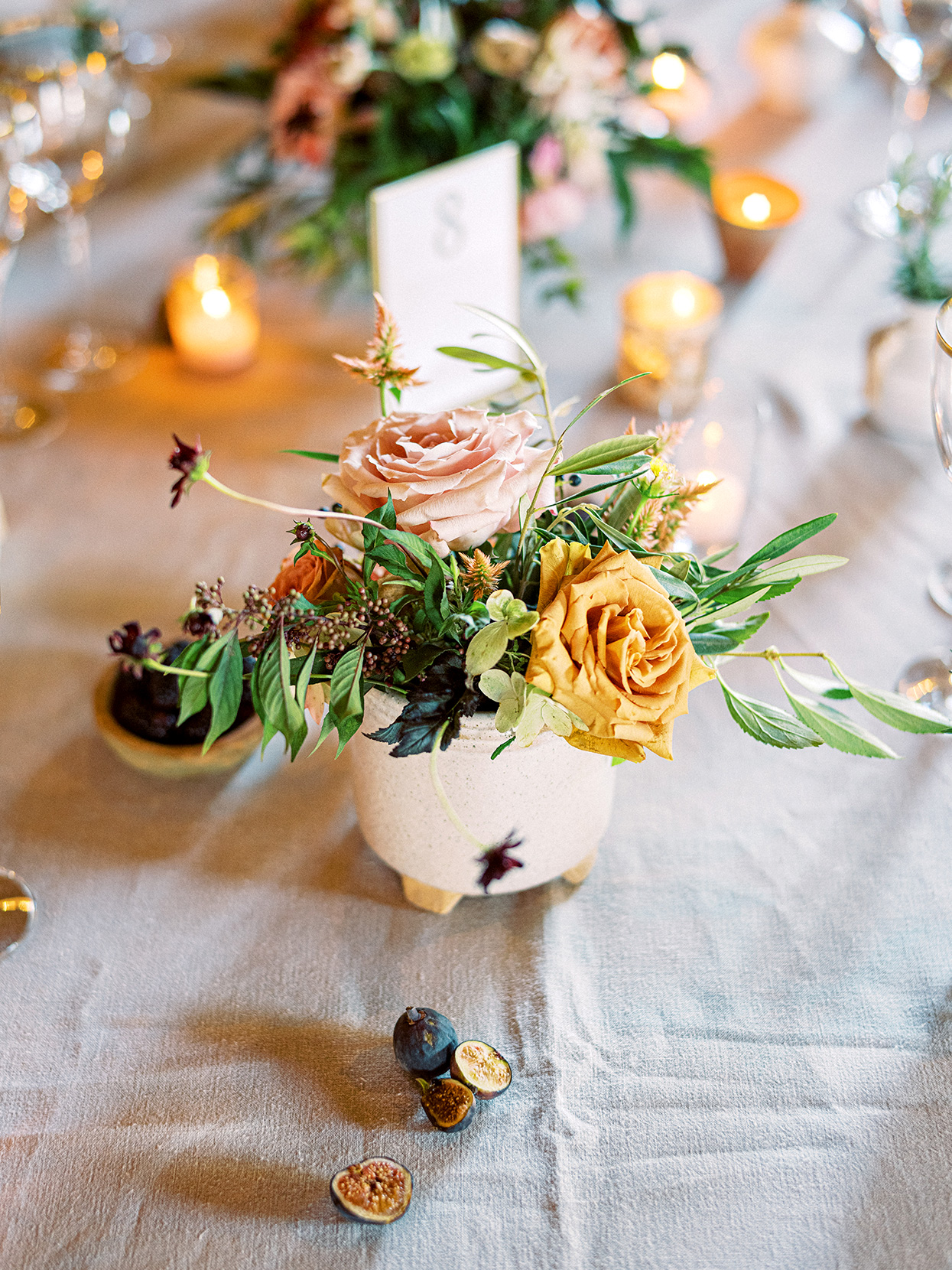 Claire and Dan small romantic centerpieces on table