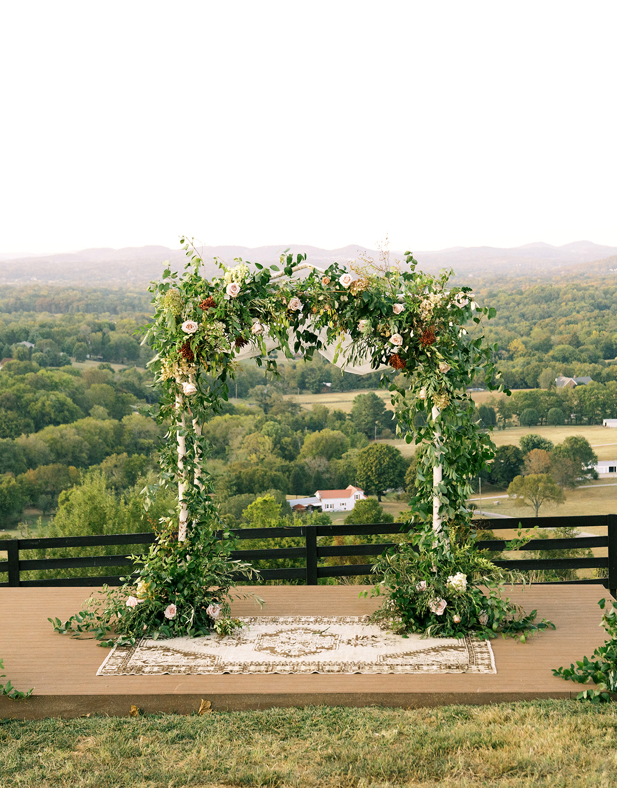 Claire and Dan's outdoor lush wedding Chuppah overlooking valley