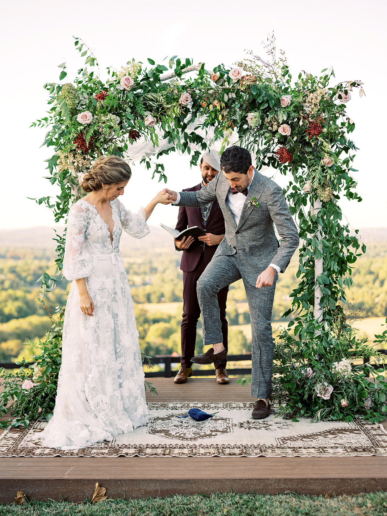Claire and Dan's outdoor ceremony with groom stomping glass