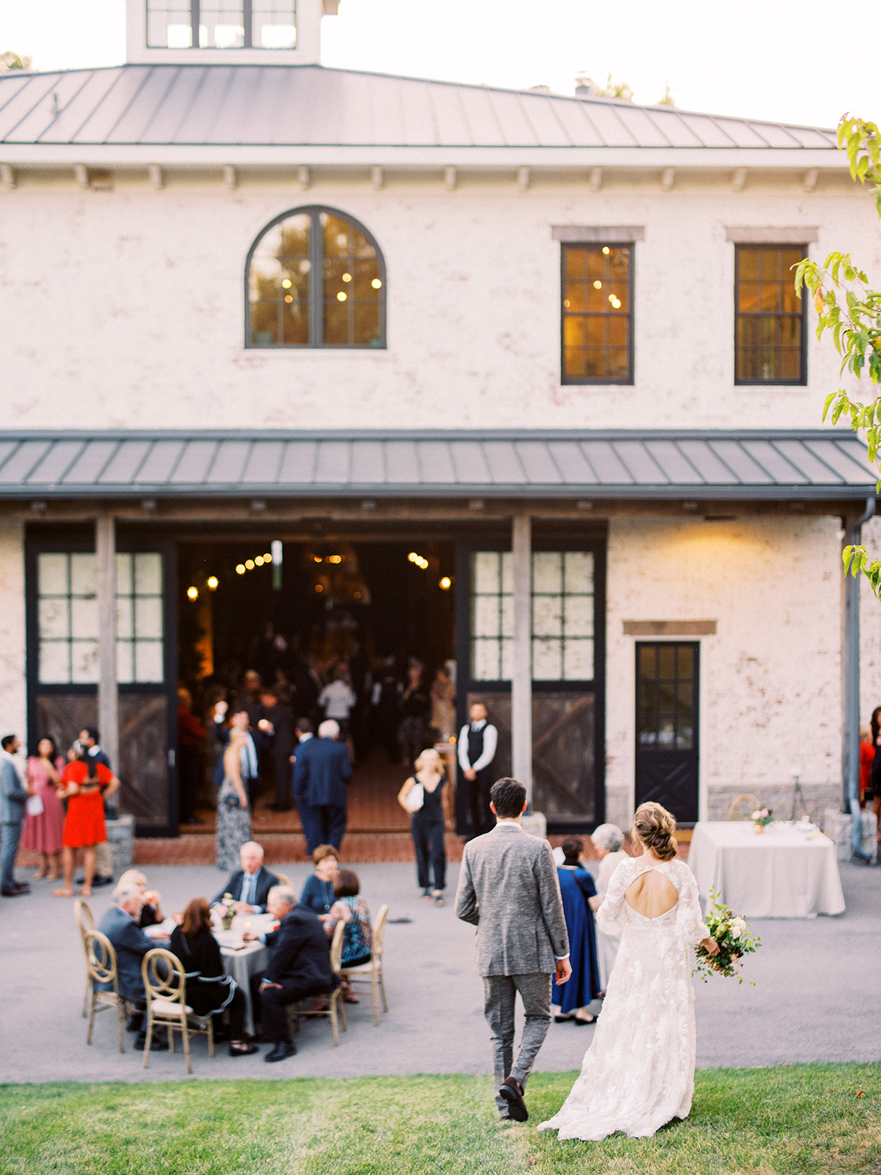 Claire and Dan entering indoor-outdoor cocktail hour