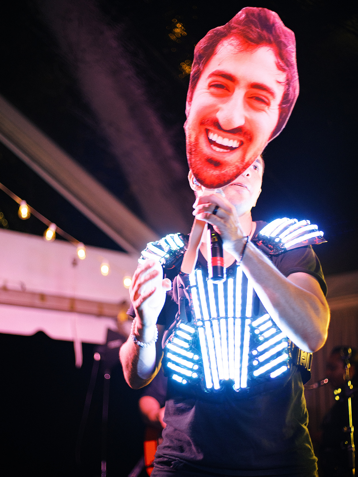 reception dancer with lights and cutout of Dan's face
