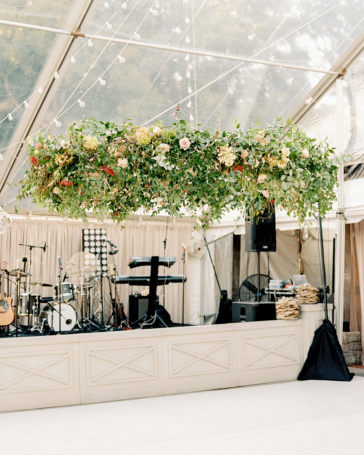 Claire and Dan's reception tent greenery installation above dance floor