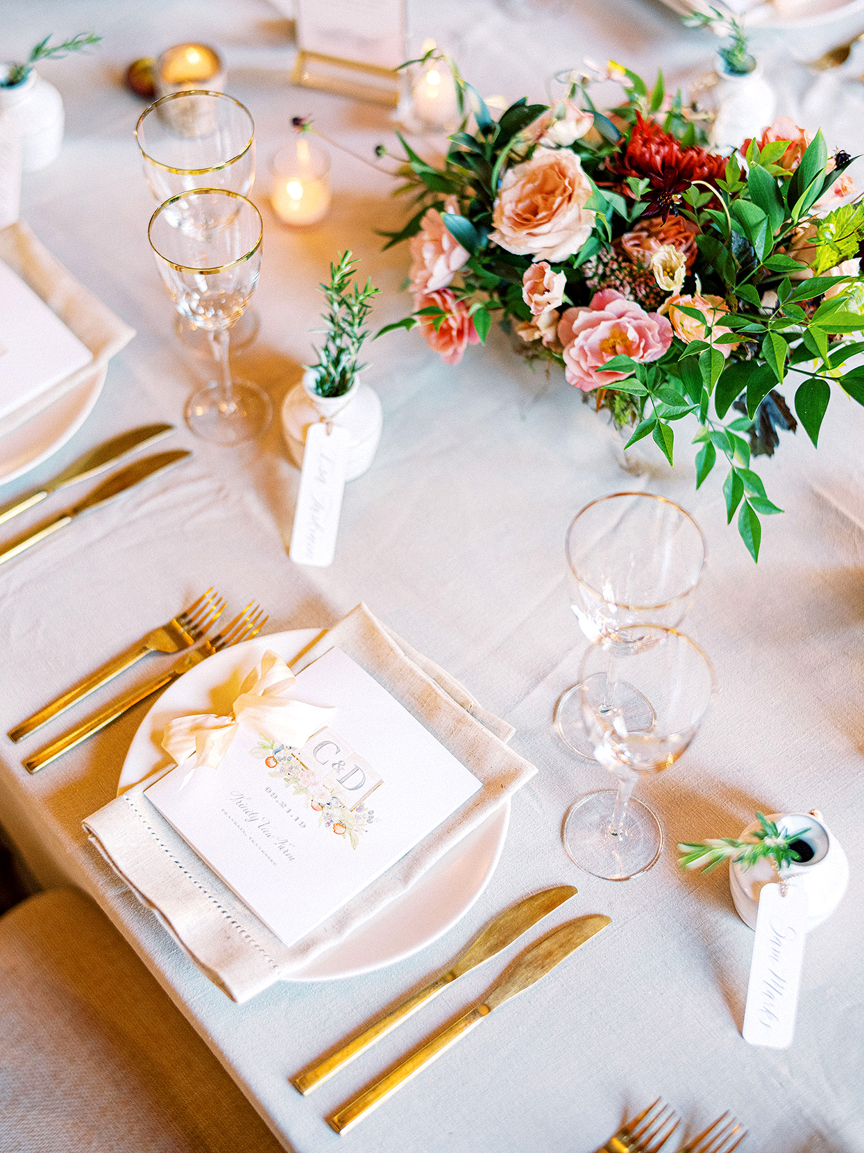 Claire and Dan's wedding reception place setting with gold cutlery