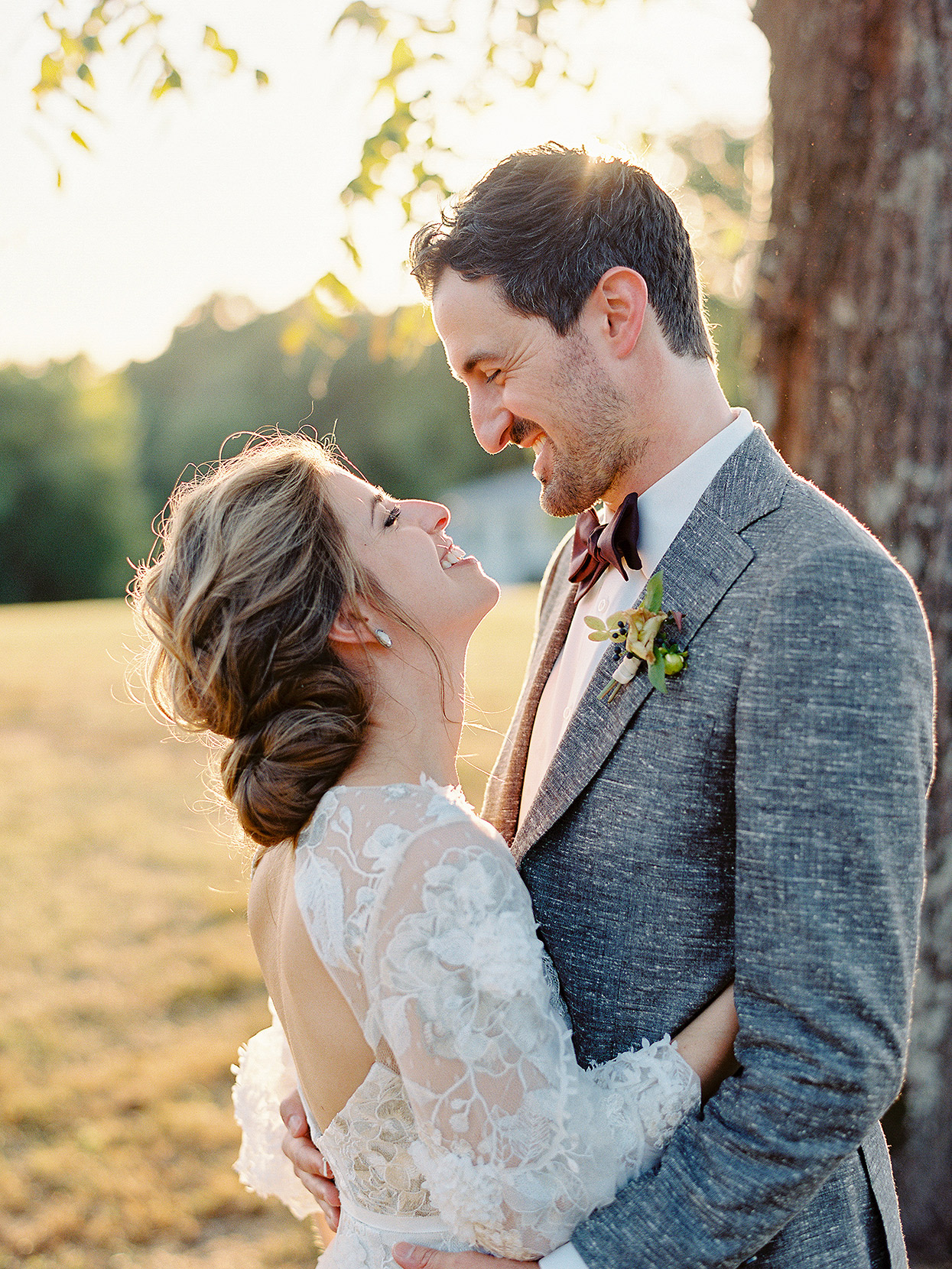 outdoor portrait of Clair and Dan smiling and embracing