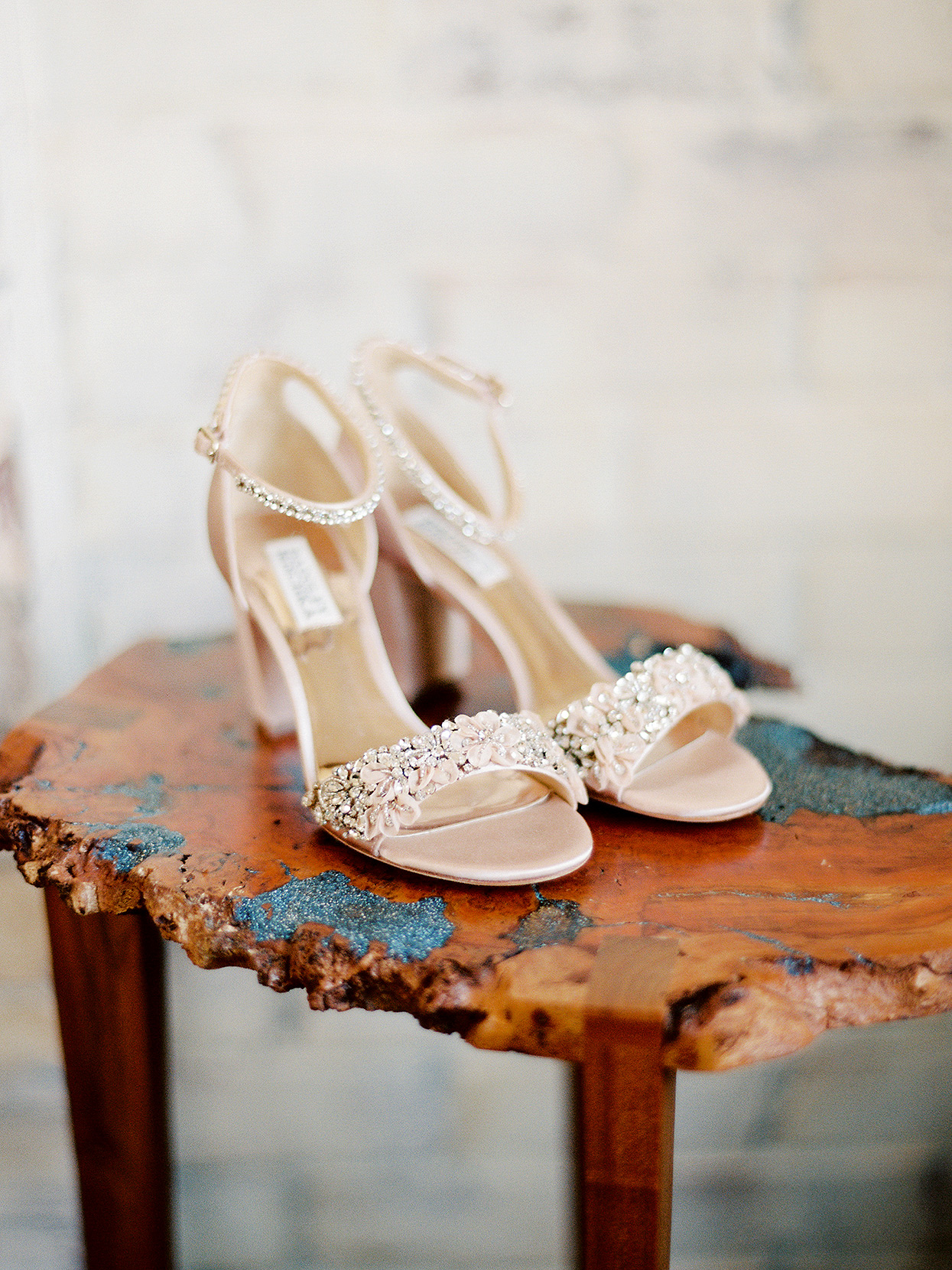 The bride Claire's wedding shoes on natural side table